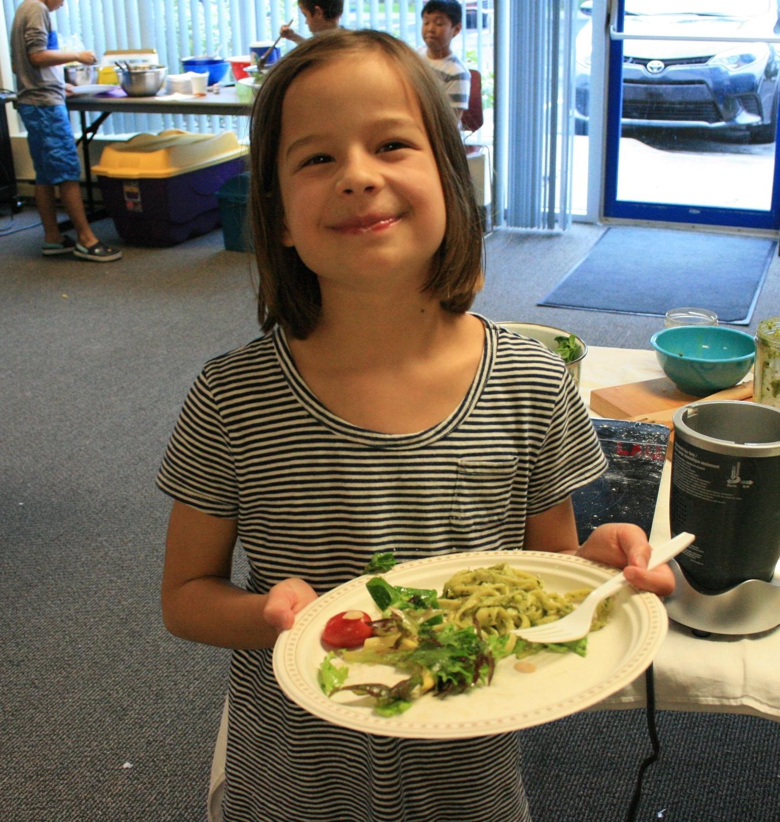 This kid ate three helpings of salad!