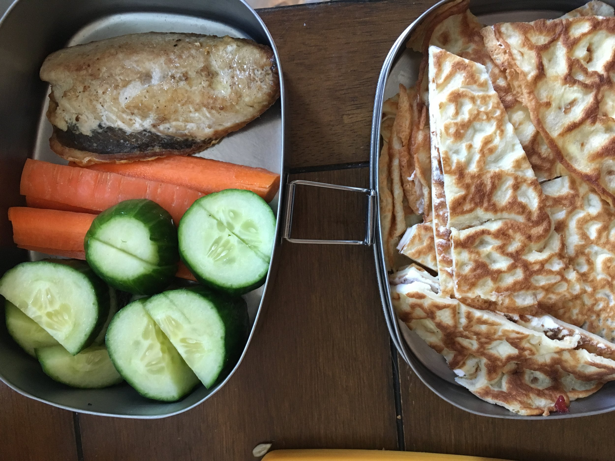 Forest School Lunch Day 2 (I forgot to photograph Day 1)! Fried mackerel, raw carrots and cucumbers (L); leftover crepe with cream cheese and jam (R).