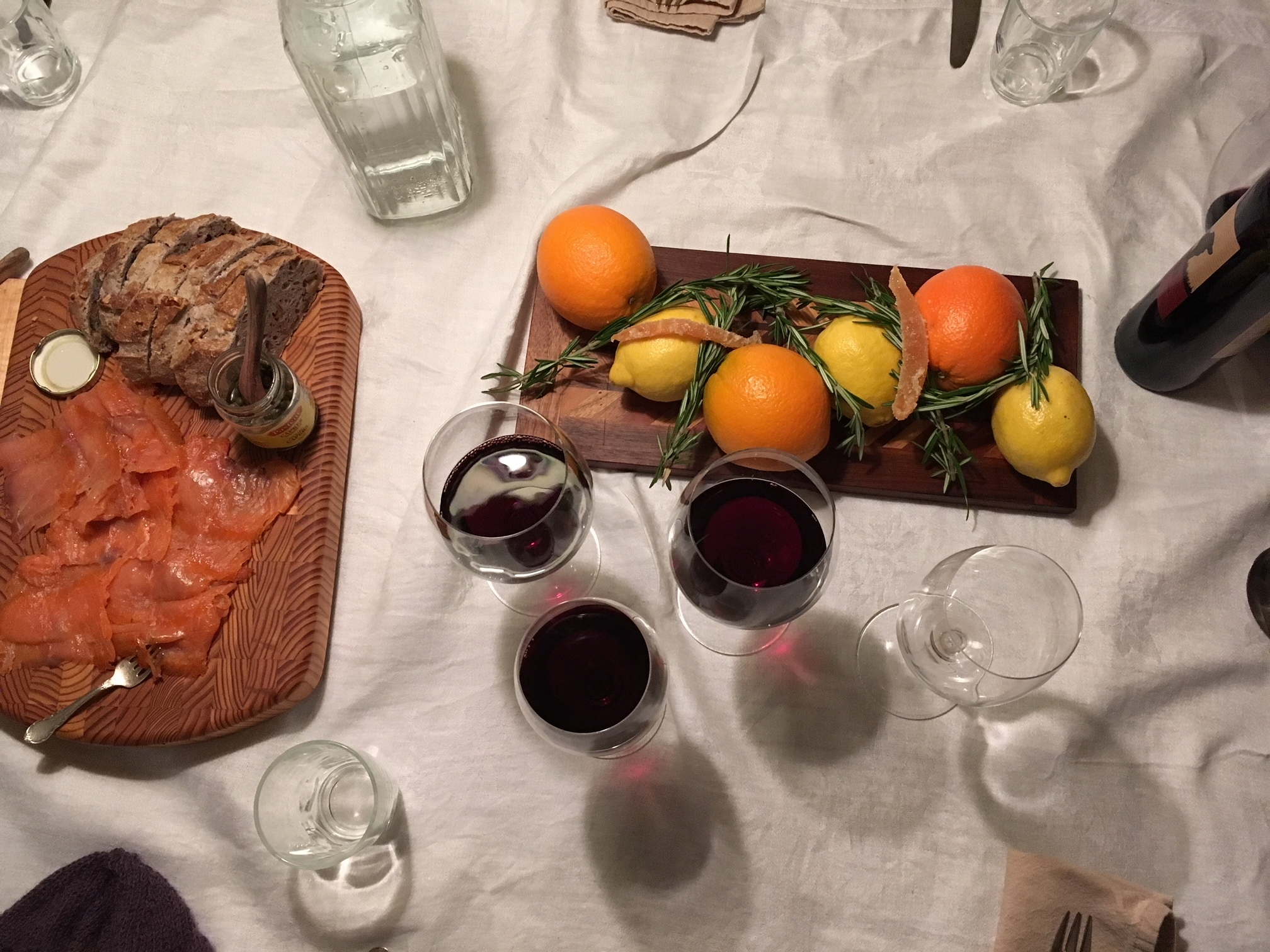 Smoked salmon and a festive centrepiece: a table set for a holiday dinner with friends