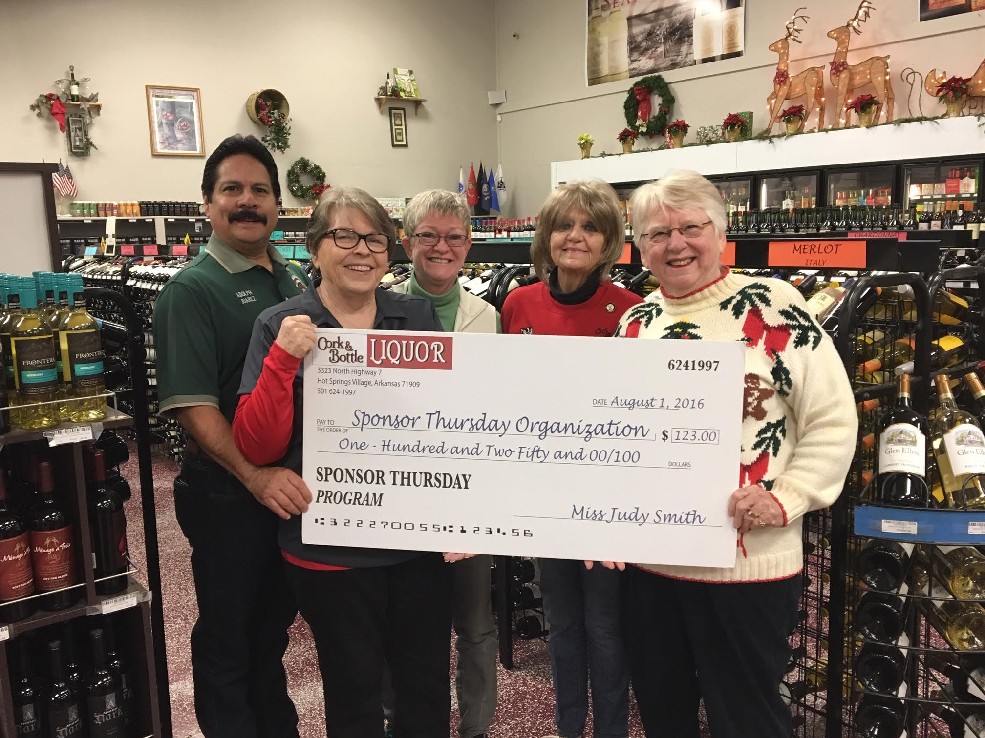 Cork and Bottle supports local non-profits. In this case they gave HSV Audubon $146.00, Left to right: Membership Chair Adolph Juarez, President Norma Wall, VP Karen Geiger, Judy Smith of Cork & Bottle, and Ecology Camp Chair Teri LaBove.