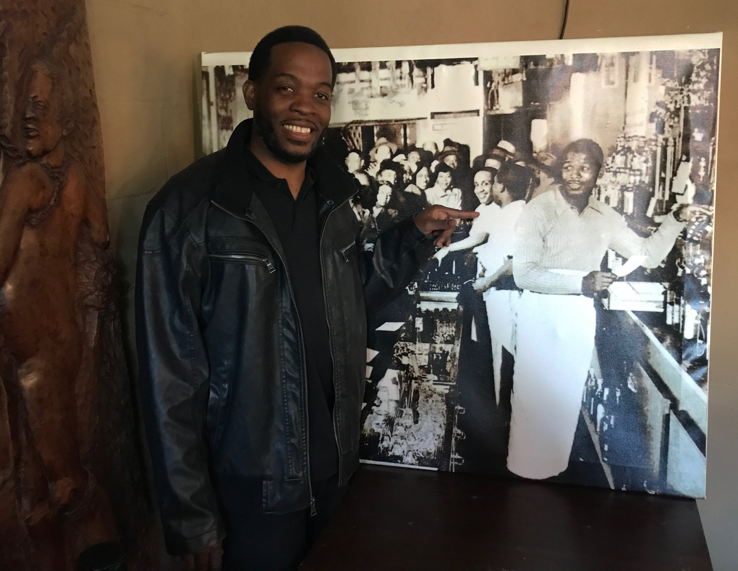 reggie wilson with the photo of sugar ray robinson that sparked woodie king, jr.'s great idea.