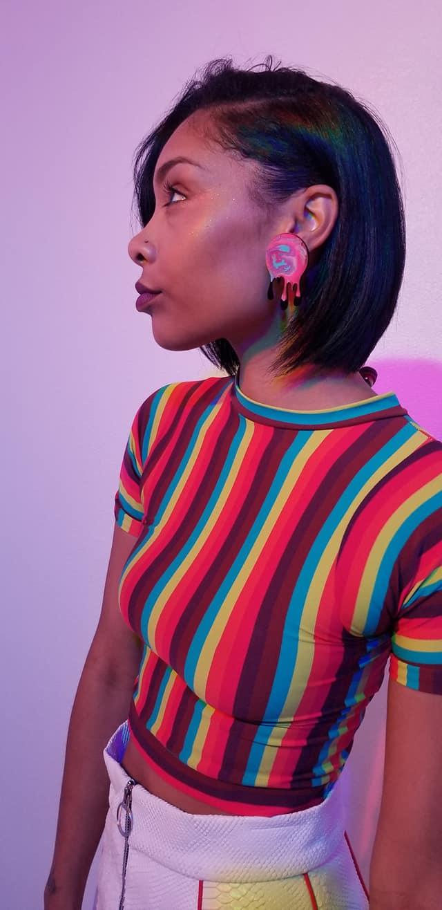 Sanay rocking a pair of  Drip Acrylic/Enamel Earrings