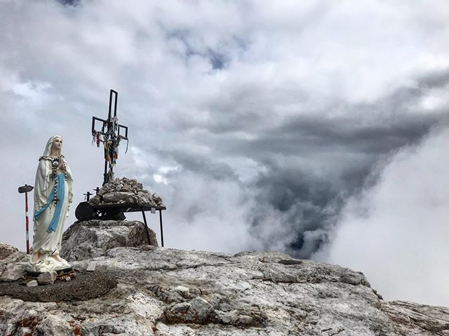 This is one of my favorite shots of the trip so far. Summit of Piz Boe 3152m. It was a fog out that morning, but the clouds were doing some magic.  The mountains hold a high reverence for me and I feel a deep spiritual connection to a higher being and all that is when I'm in places like this.  In Italy like I also felt in Nepal, there is a spiritual reverence on their peaks. This photo for me captures it.  I was raised catholic, became non-denominational Christian as a teen and now also practice/student for life of Buddhism. I pray before each time I step foot on a mountain giving gratitude and asking her to be kind. I know Mother Nature calls the shots and it's a blessing to just be there.  I feel small but part of something so much bigger than I could ever fathom. I'm reminded that I am part of the earth and all that is. We all are. Hence we must protect it.