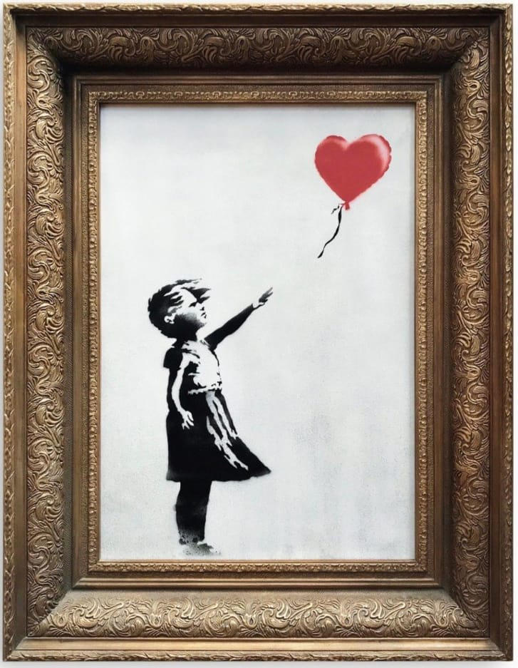 An image of Banksy's Girl with Red Balloon painting that self-destructed just moments after being sold in London. Credit: Sotheby's
