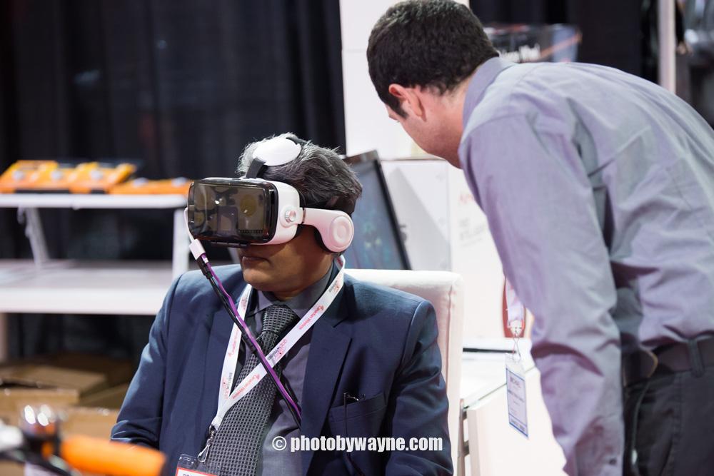 man-trying-virtual-reality-device-trade-show-photography-toronto
