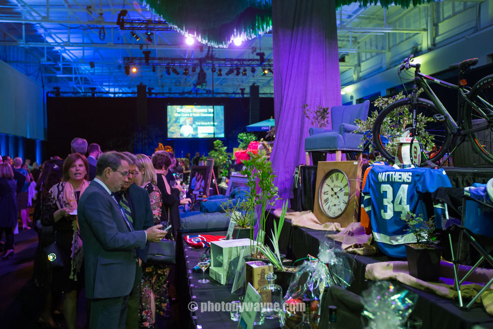 23-two-men-in-front-of-silent-auction.jpg