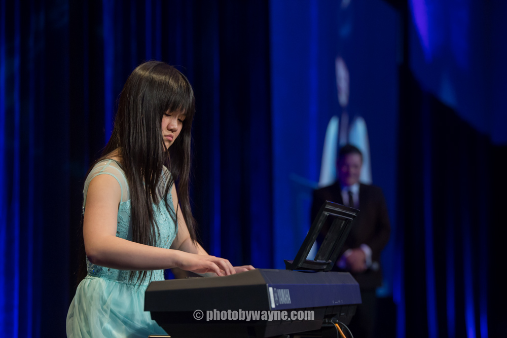37-young-girl-perform-piano-friends-we-care-dinner.jpg
