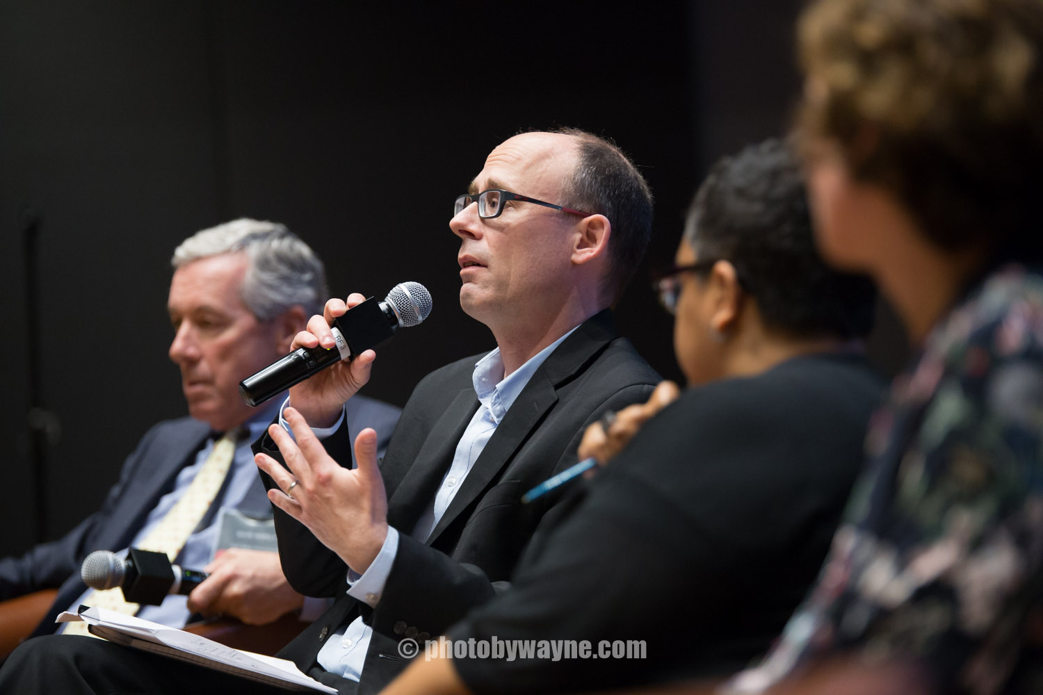 16-basic-income-guarantee-conference-guest-responding-to-questions.jpg