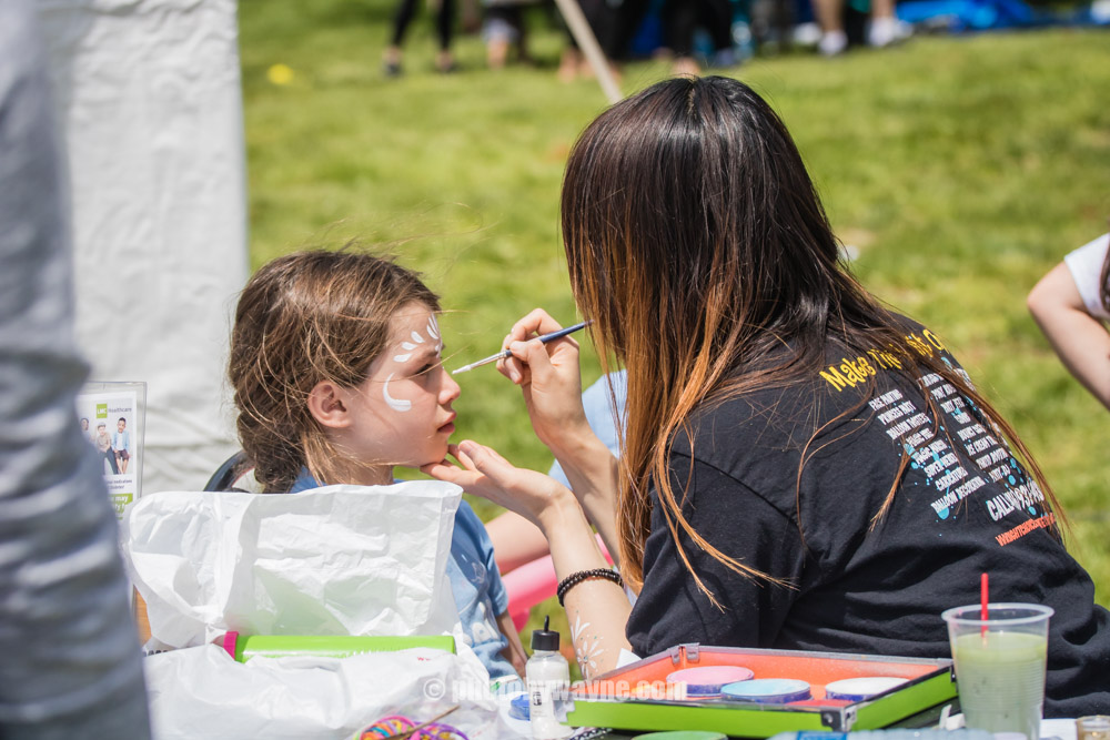 64-young-girl-face-painting-outdoor-event.jpg