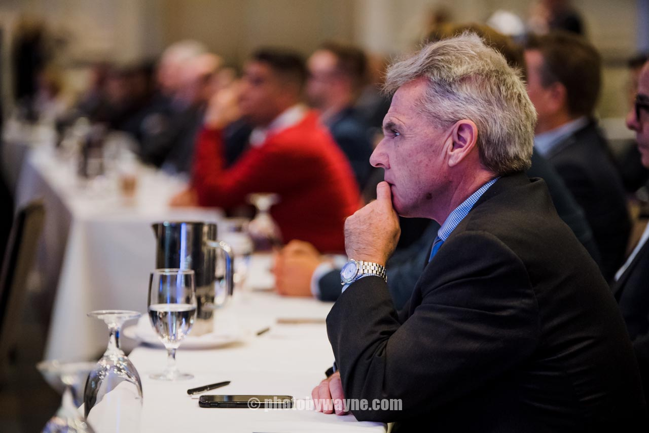business-conference-attendee-paying-attention-to-speaker.jpg