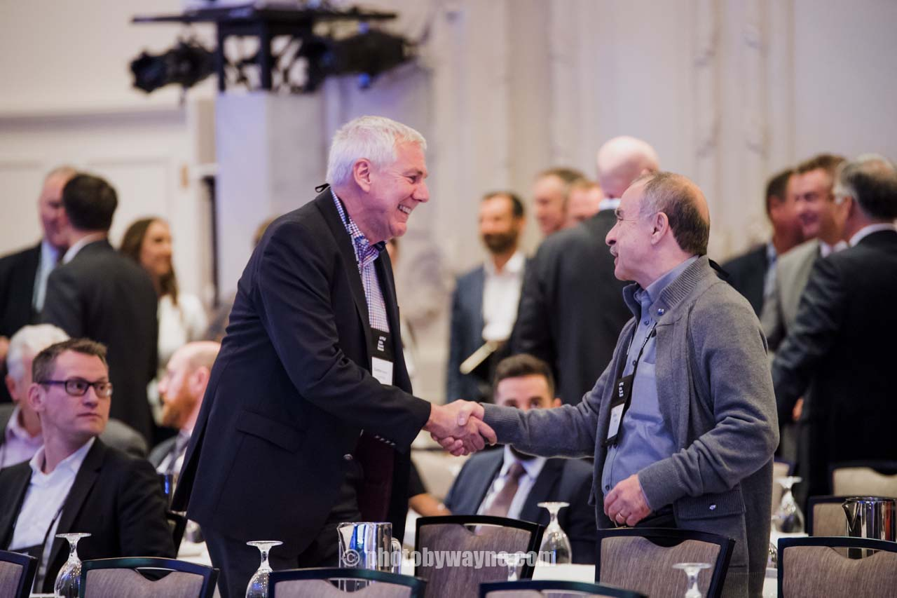 two-men-shaking-hands-business-conference.jpg