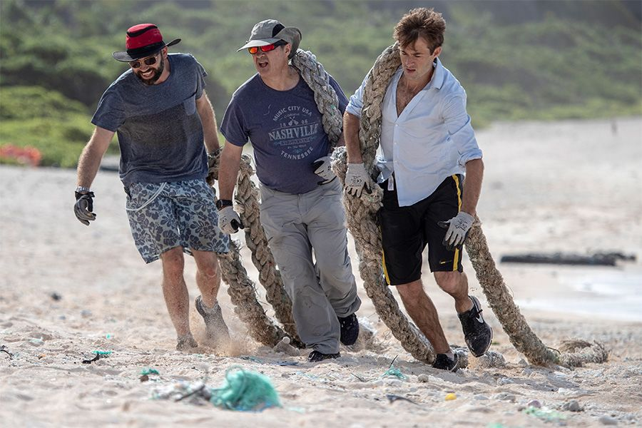 Expedition members (L-R) James Beard, Pitcairn Islands Deputy Governor Robin Shackell and Pew Trust-Bertarelli's Johnny Briggs harnessed their energies to clean up Henderson Island's foreshore.