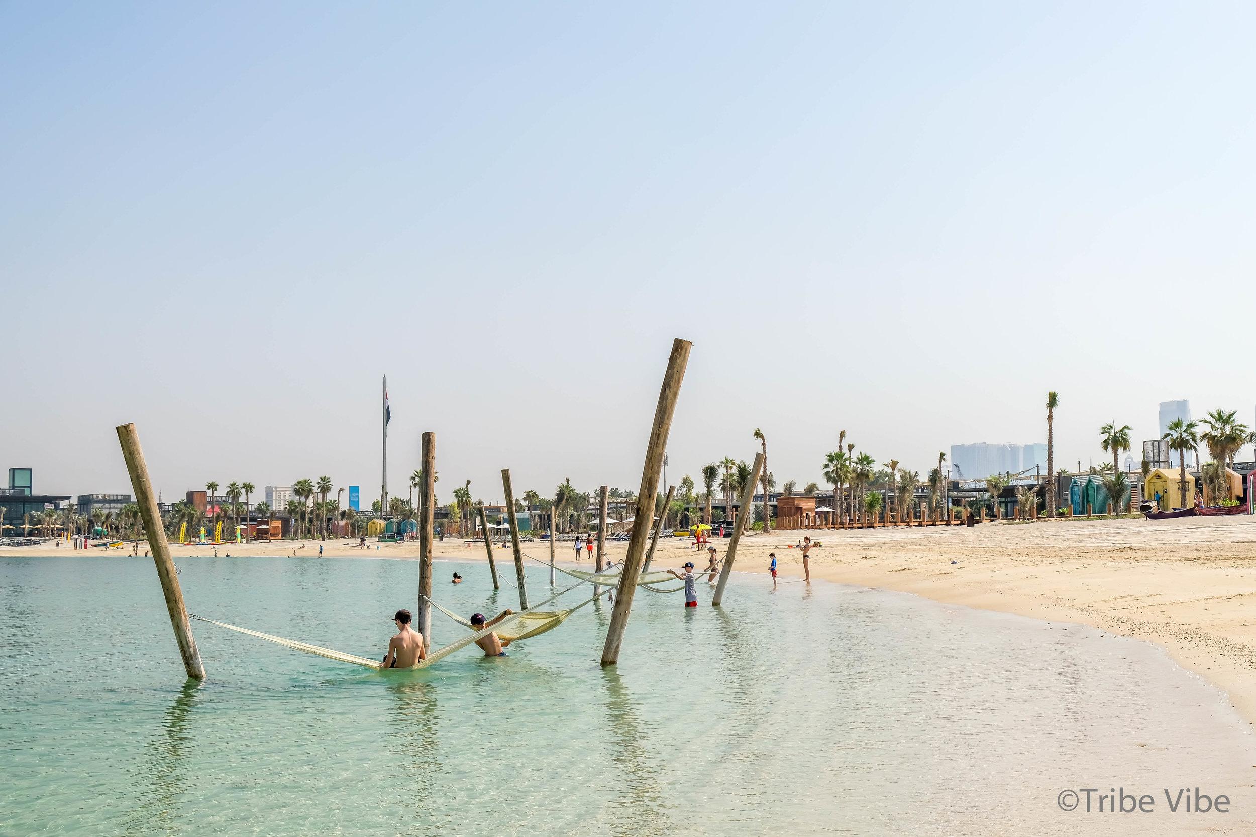 Swinging in the sea hammocks at La Mer beach, Dubai