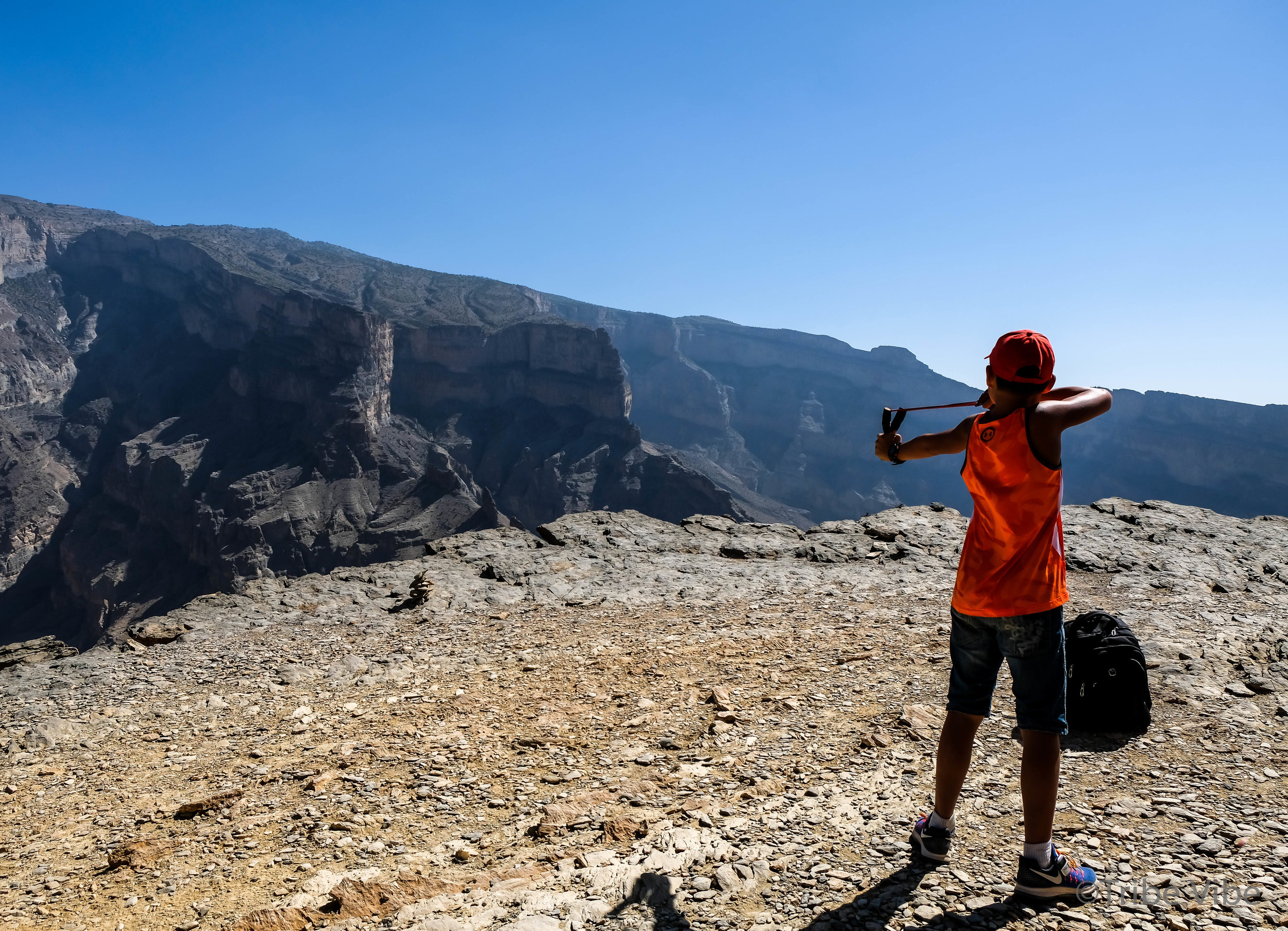 Learning how to use the slingshot. Balcony Hike, Jebel Shams, Oman.