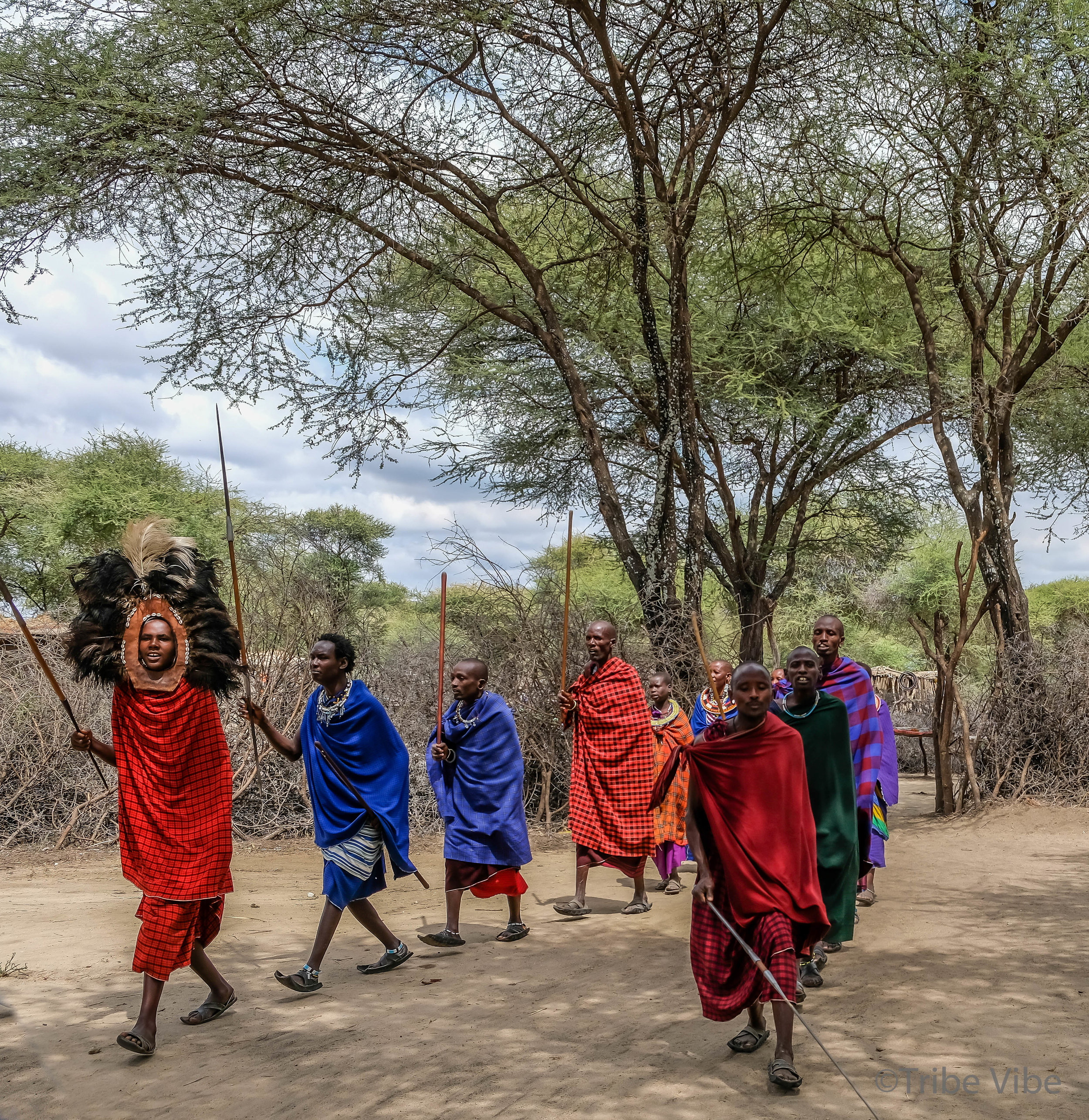 Being greeted with a traditional Masai welcome song and dance