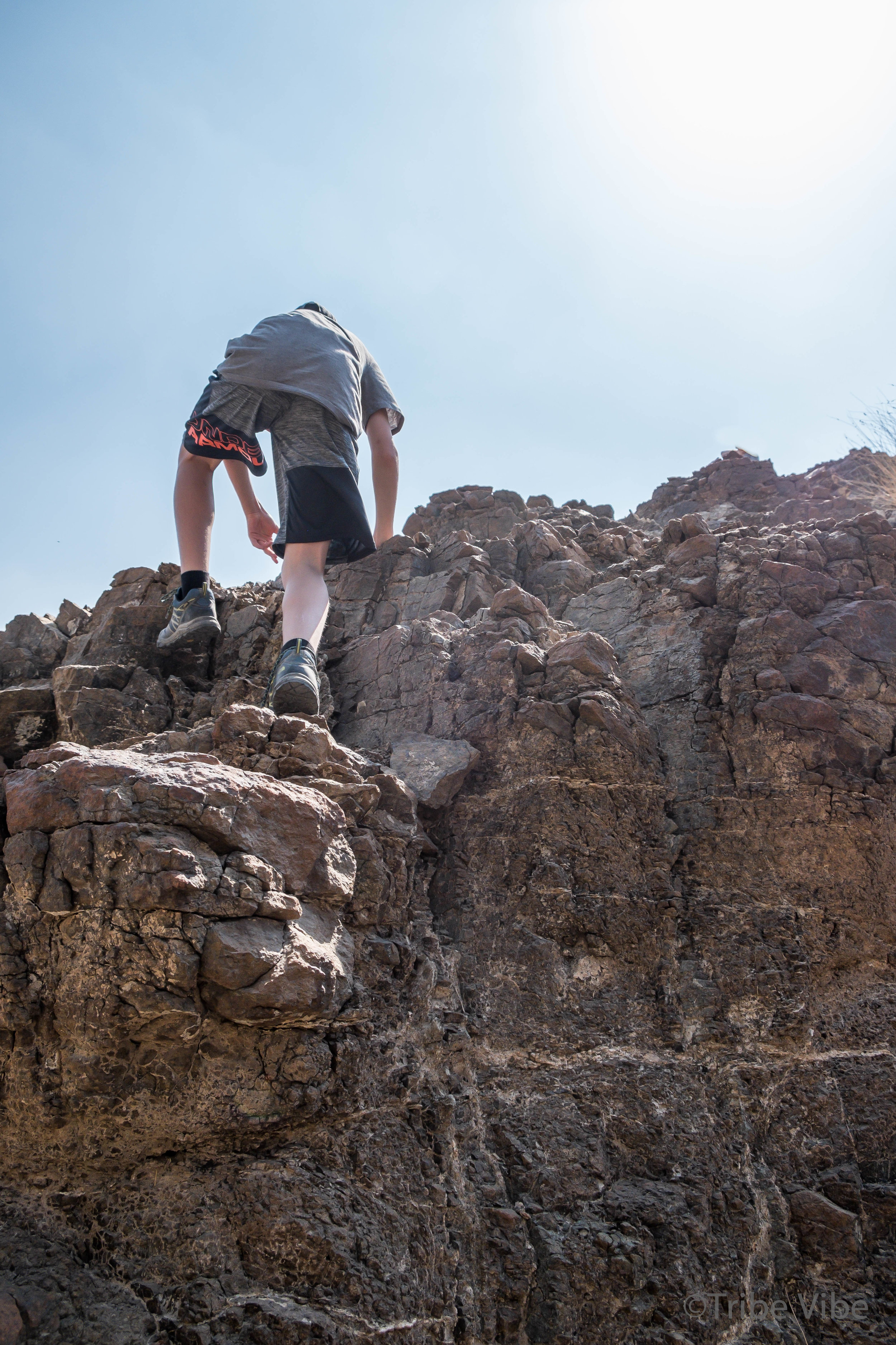 boys climbing rocks on camel farm hike UAE2.jpg