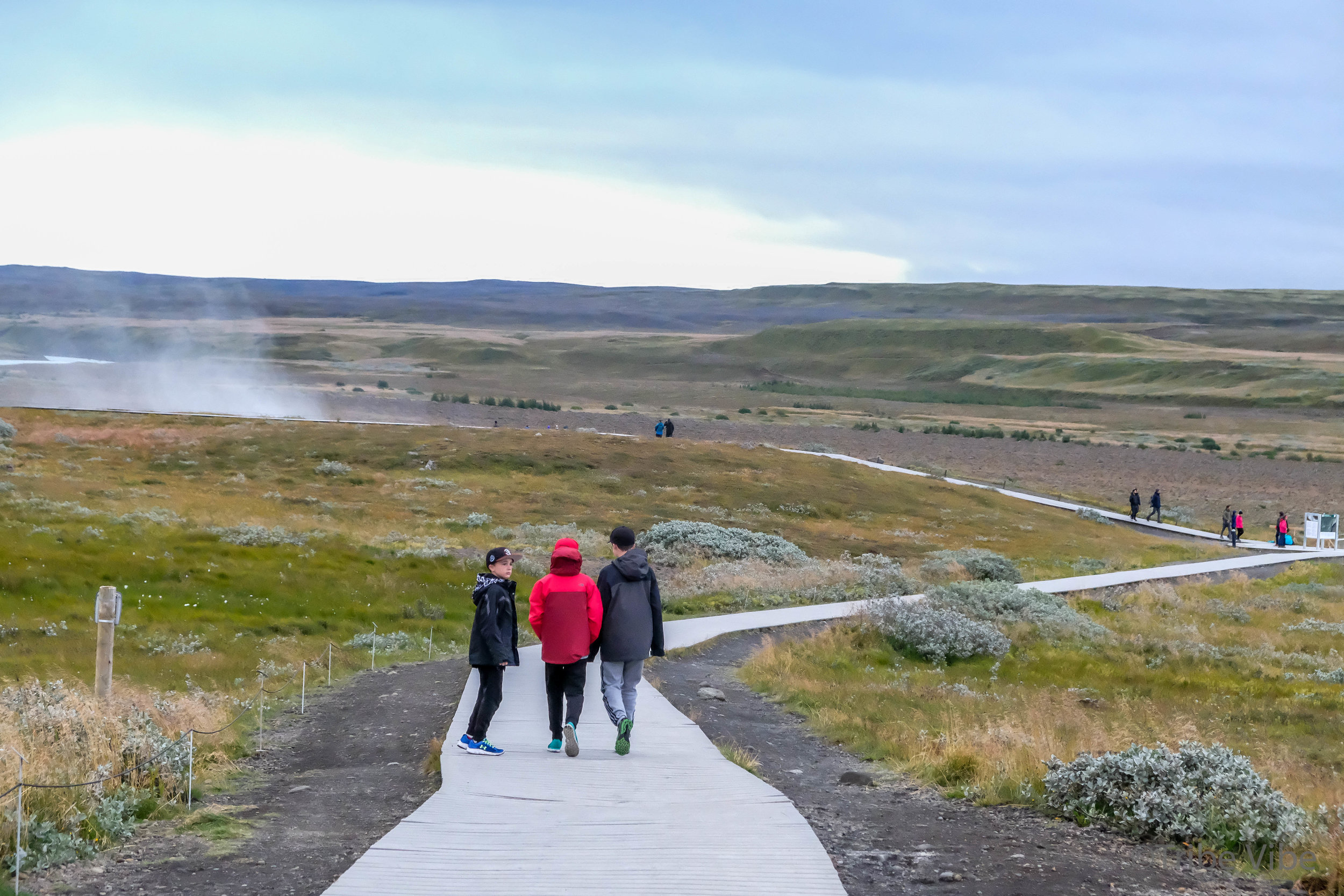 walking to find Strokkur in the Golden Circle of Iceland. Geyser. Family RV road trip through Iceland.