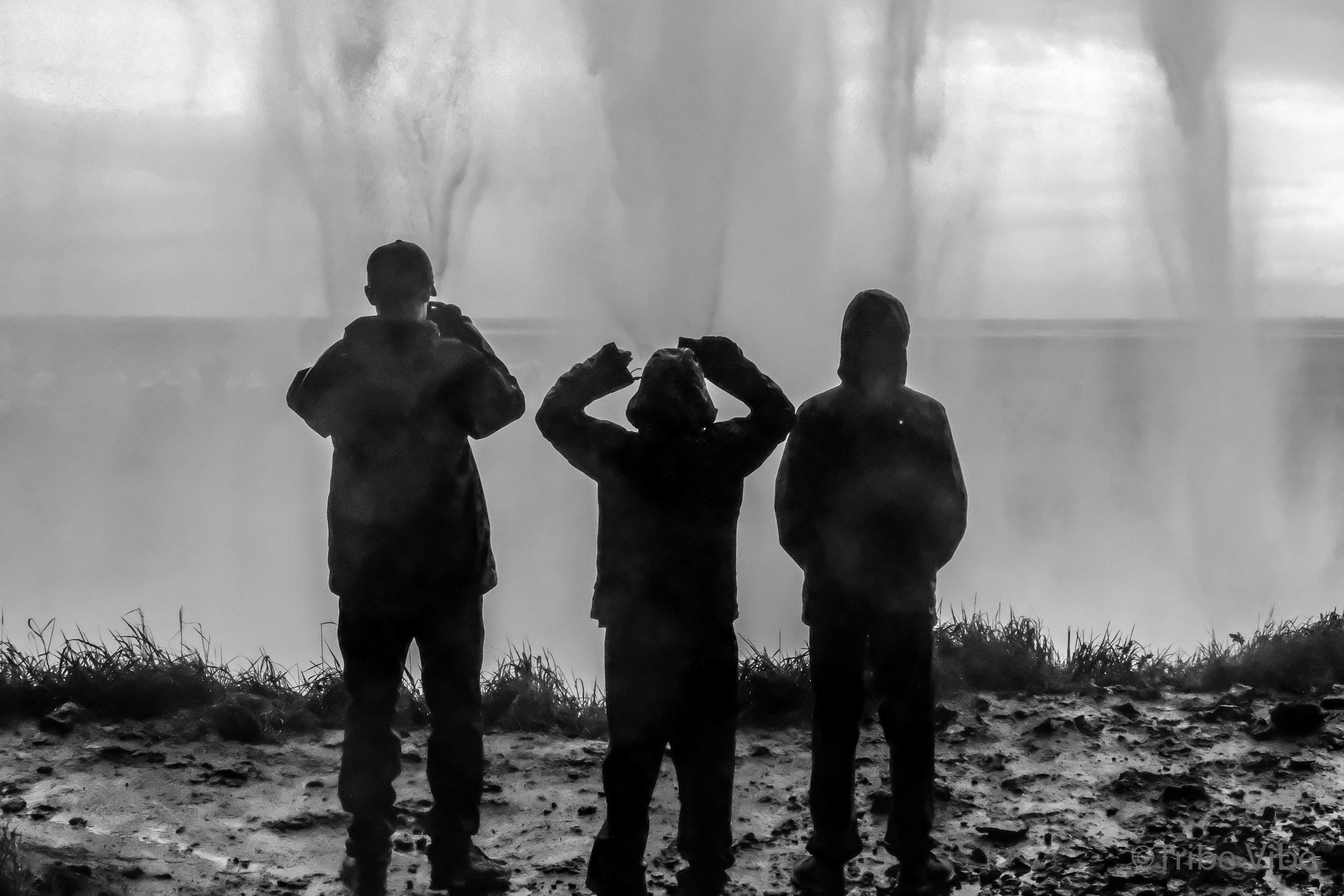 Favourite photo. Boys standing behind Seljalandsfoss trying to take a photo of the falls