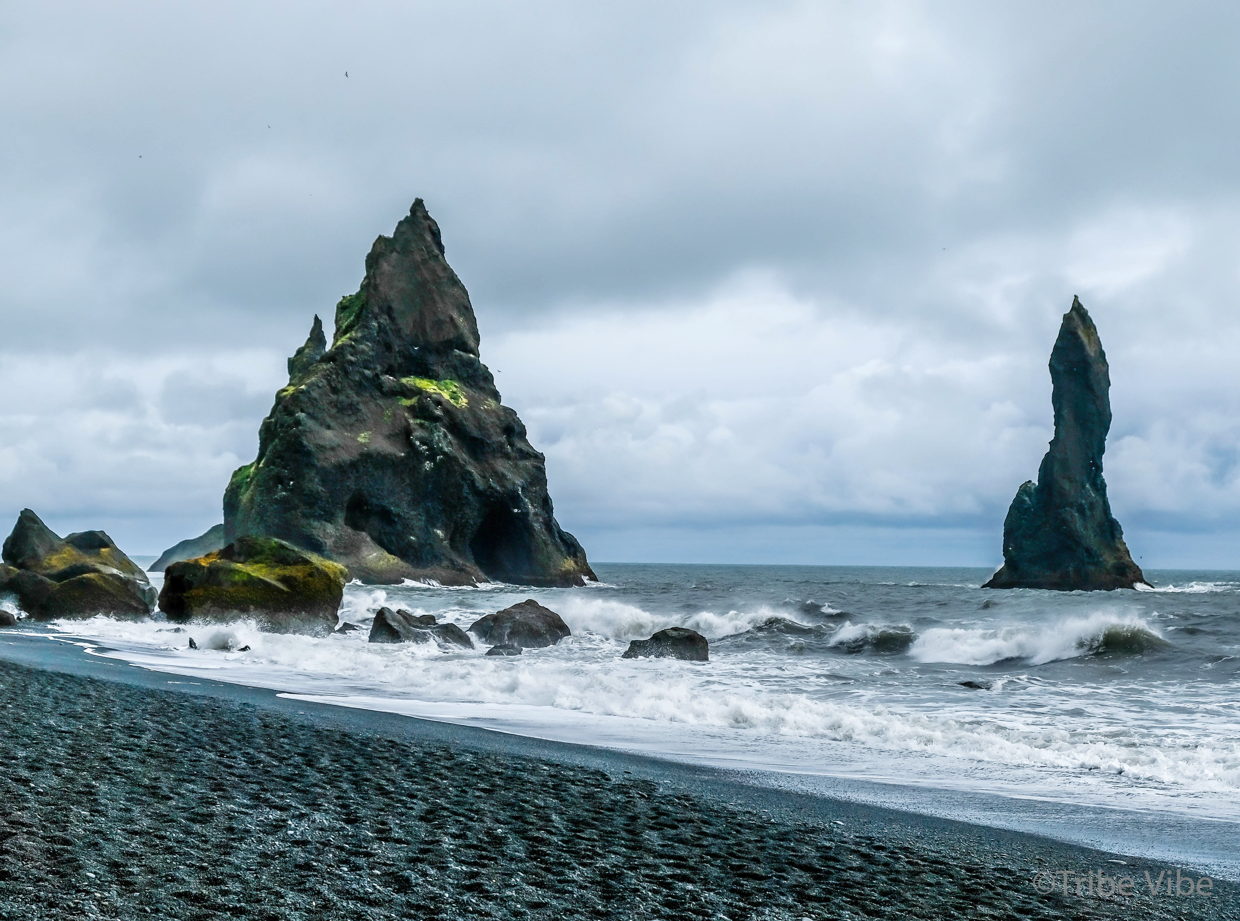 Basalt pillars in Reynisdrangar, Iceland. Family road trip through Iceland.