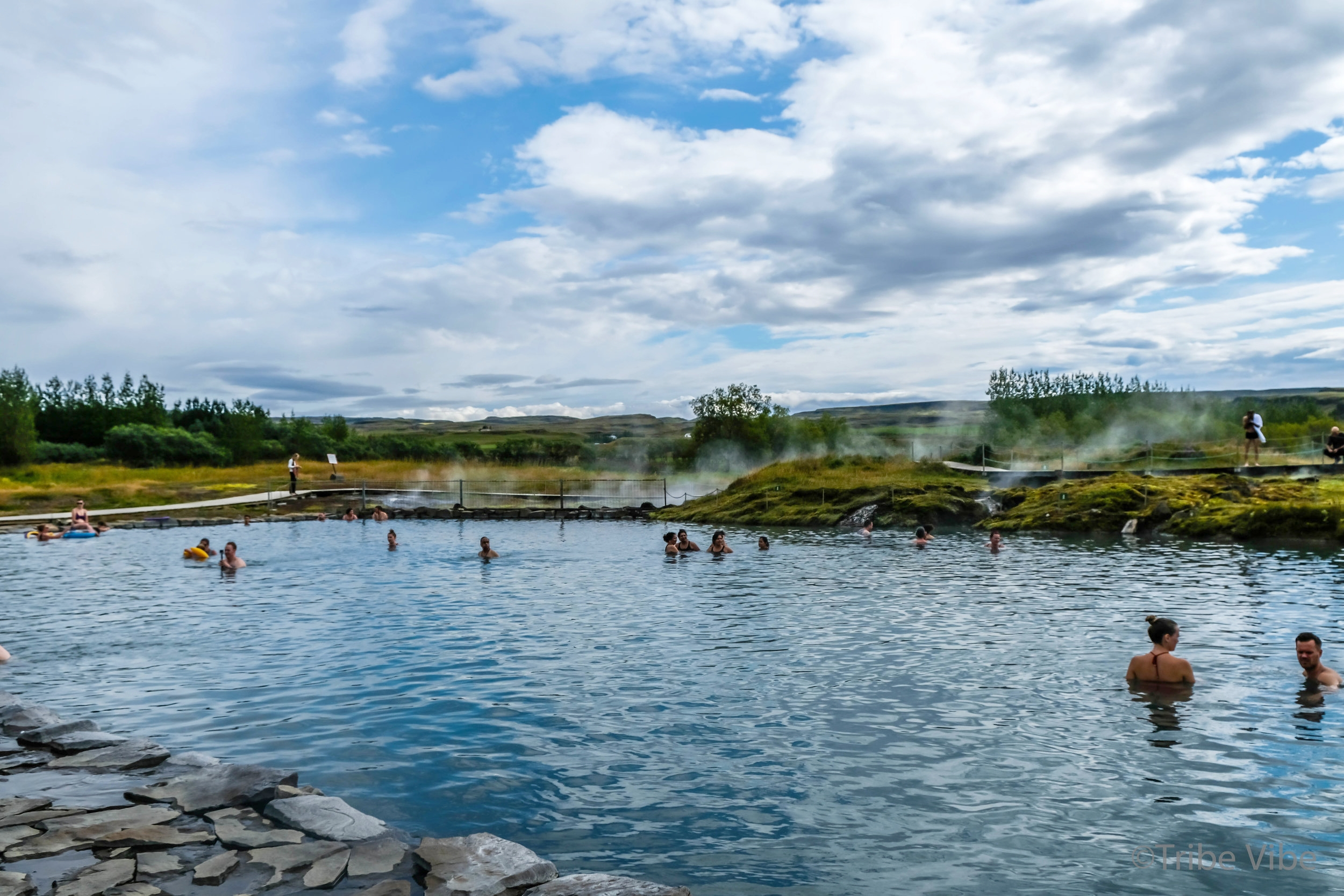 Secret lagoon in Fludir, Iceland. Family road trip through Iceland