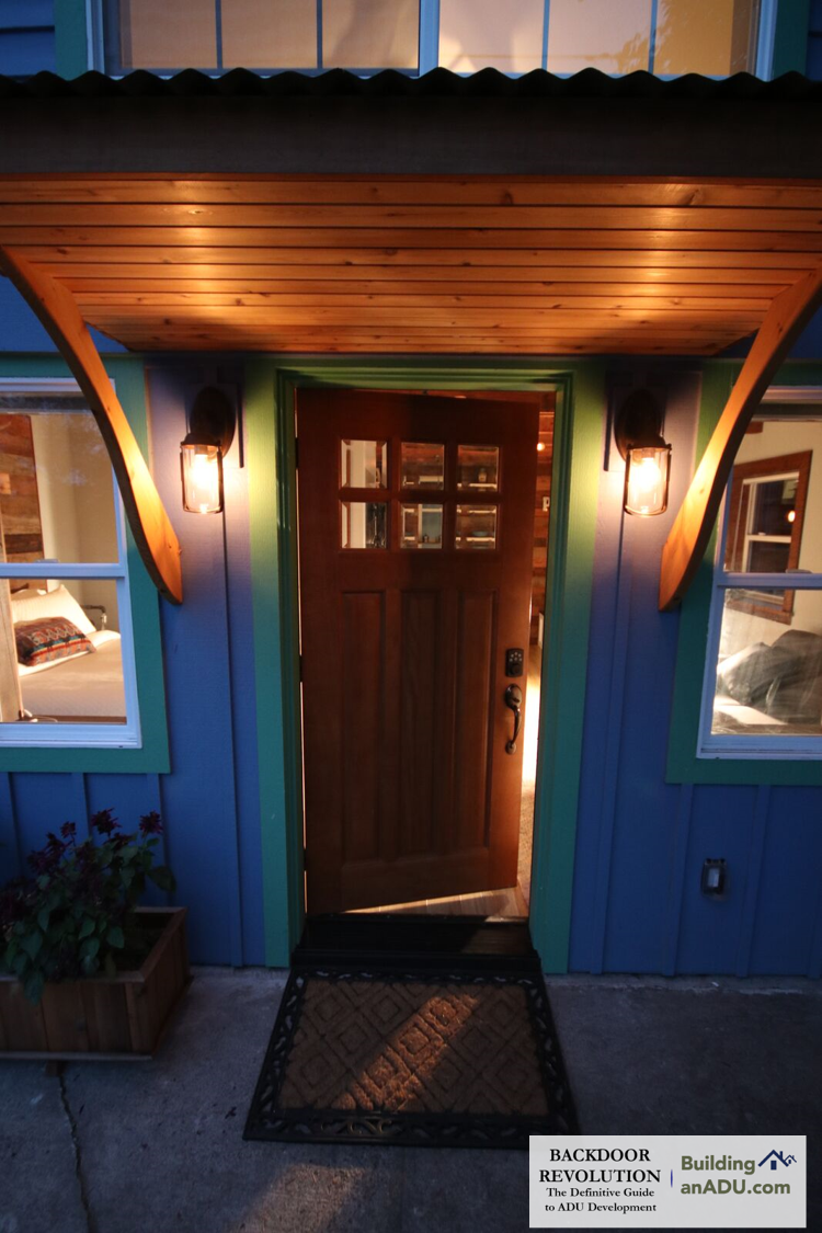 The cover image for Backdoor Revolution. This is doorway of a garage conversion ADU in North Portland.  This ADU  was featured on the 2017 ADU Tour.