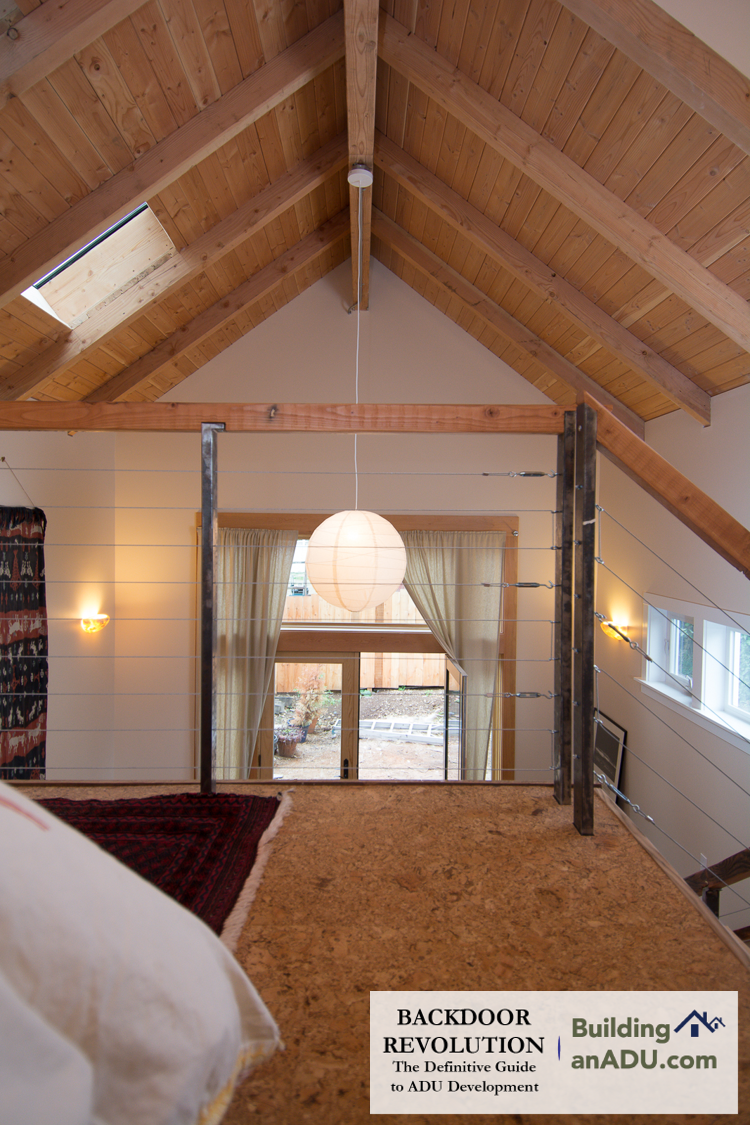 A long sight line from the lofted bedroom of an  ADU that was featured on the fall, 2015 ADU Tour .