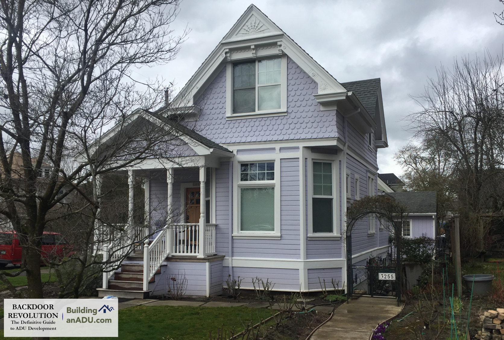 A charming victorian home with a basement ADU, whose entry is discretely tucked away on the right side of the house.
