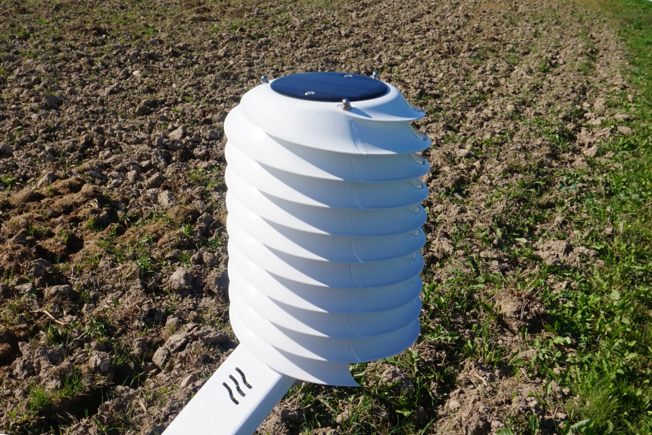 MeteoHelix IoT Pro LoRaWAN agricultural weather station in a farm field