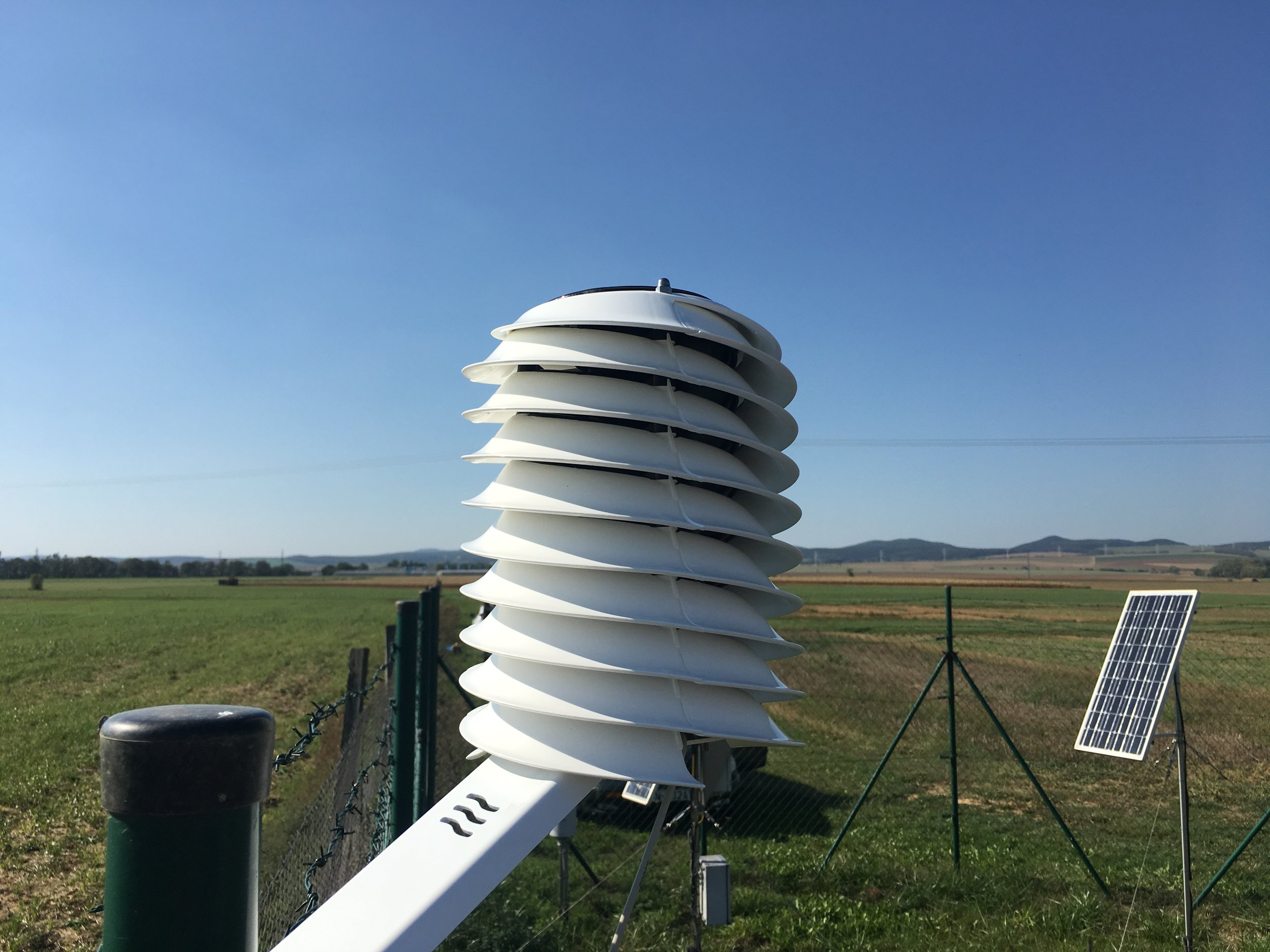 BARANI DESIGN MeteoHelix IoT Pro agricultural weather station overlooking farm field experiments