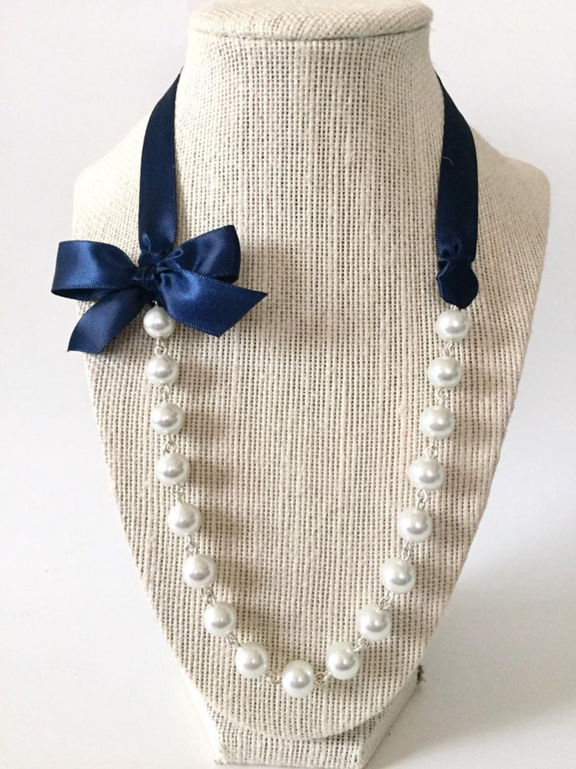 It's been said that a Belle with pearls can change the world…these pearls have a lovely accent of a bow and our perfect for an extra pop with a t-shirt. Etsy Store:   JewelryByAsheNicole