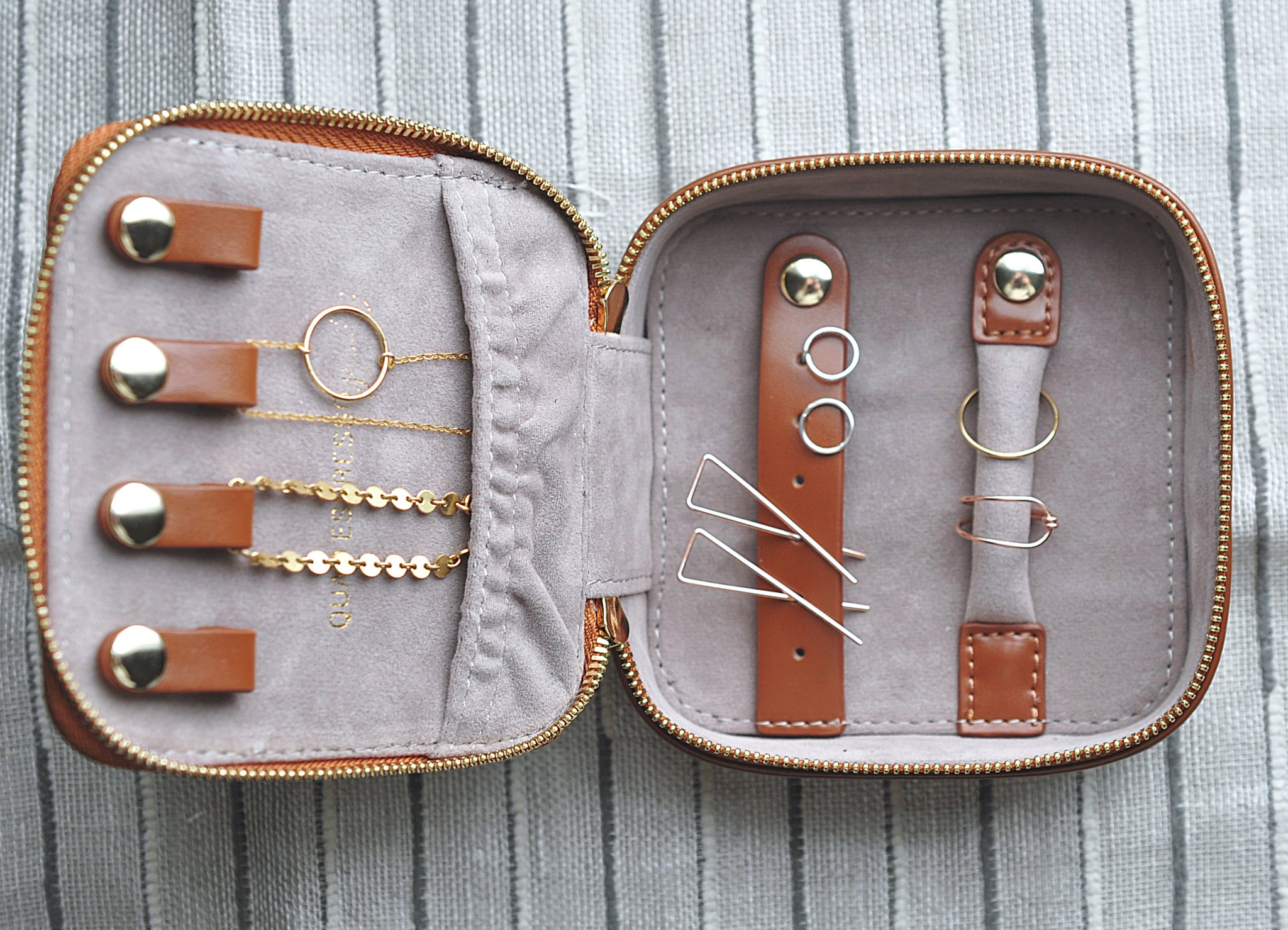This last find is not an Etsy find but it's a Belle necessity for keeping your jewelry keepsakes safe. This case is perfect for travel. Store:  Quad Espresso Jewelry