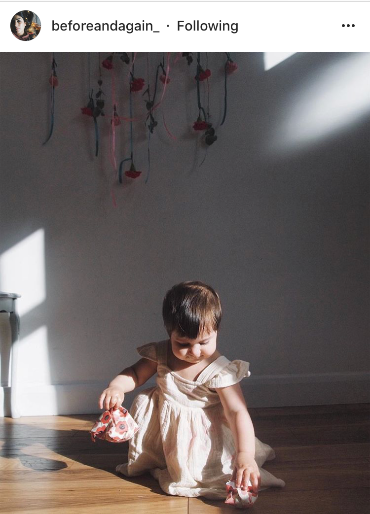 Rida  capturing the light and the angelic face of her daughter against the backdrop of ribbons and florals, if thats not whimsy I don't know what is!