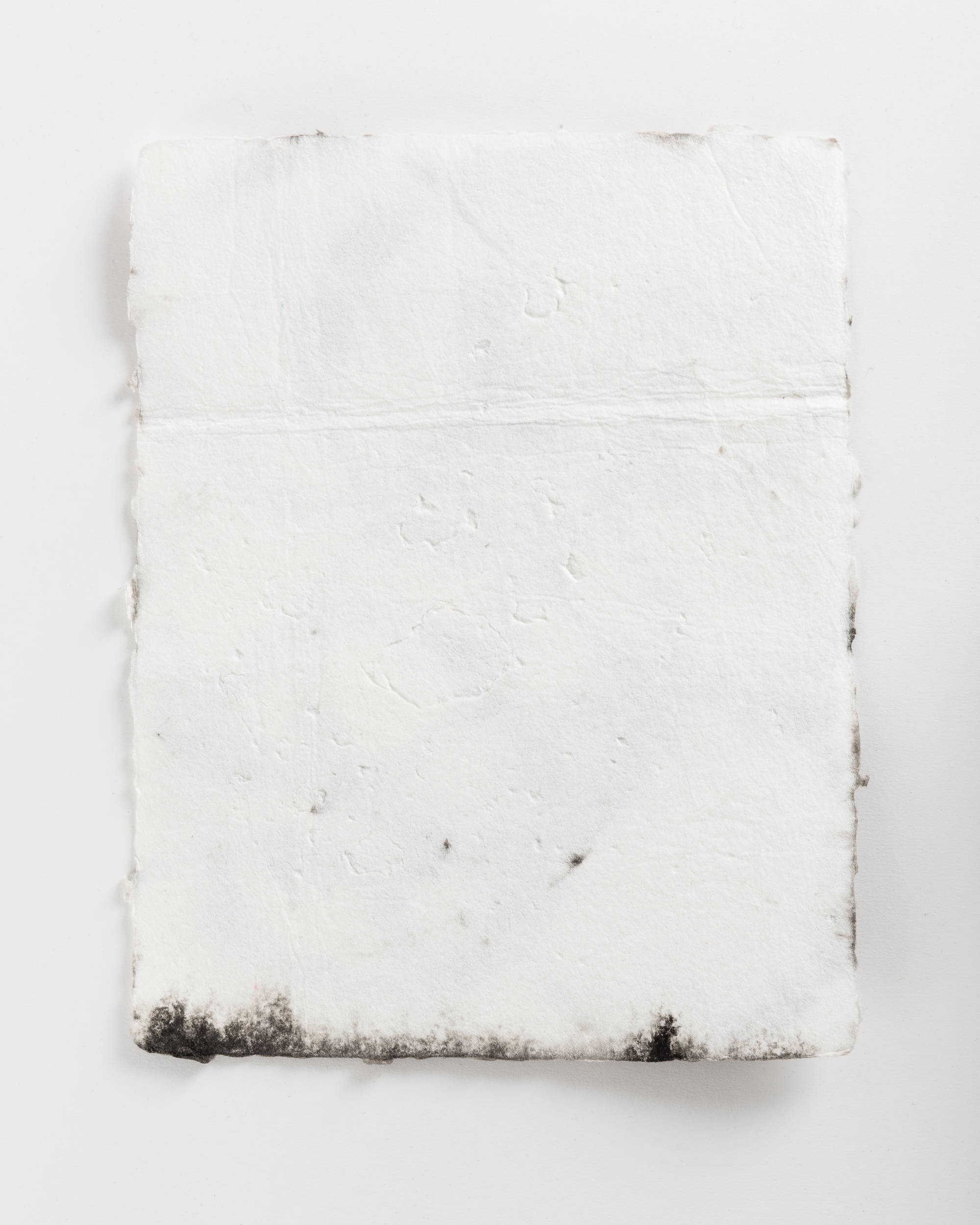 Handmade paper. Made by hydrating and beating cotton linter, and then forming 8x10 sheets onto a vacuum table and adding black pigment directly to the wet sheets.