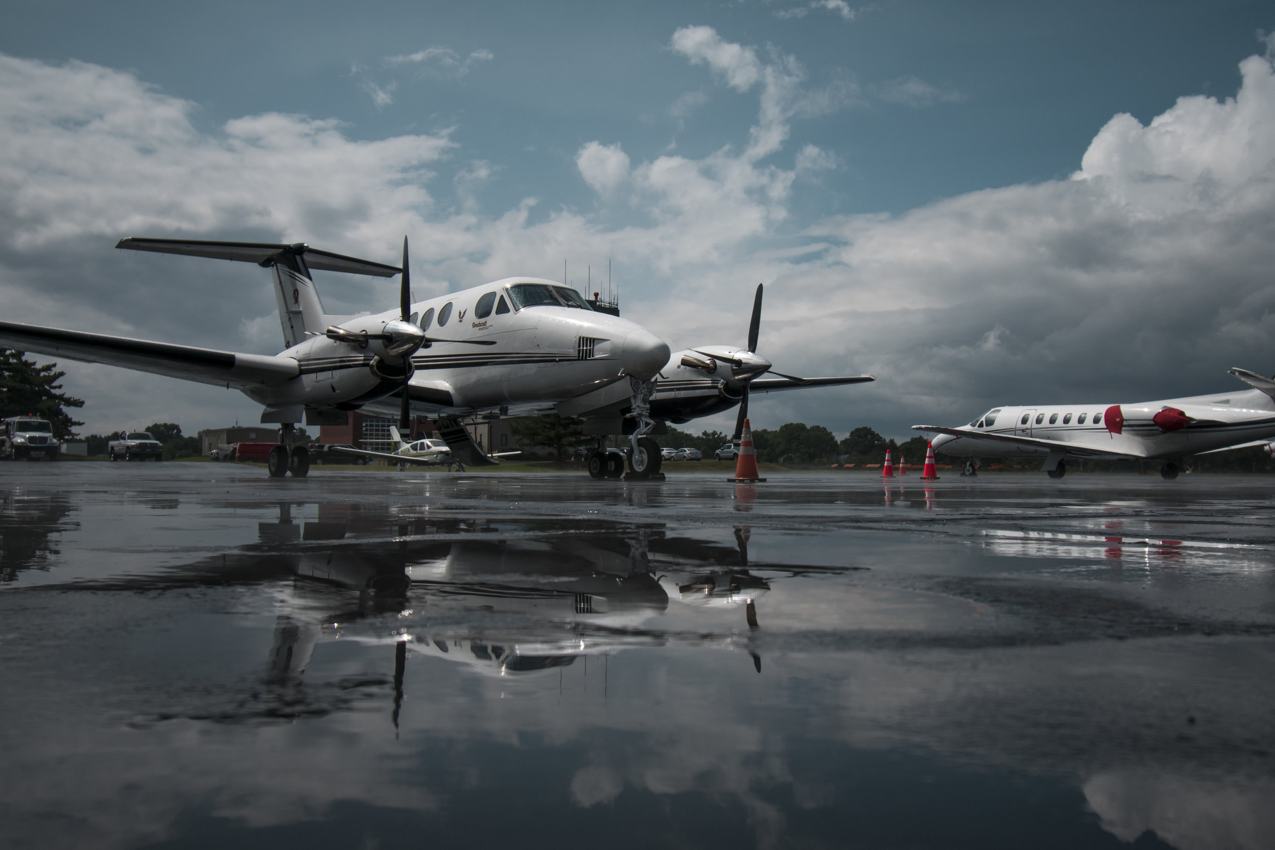 king air on ramp with reflection in puddle.jpg