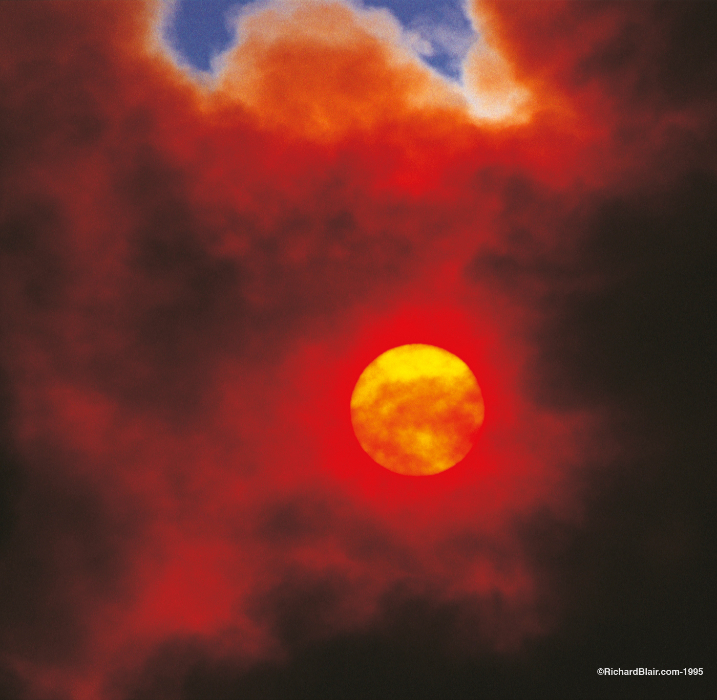 Fire Clouds over the Sun