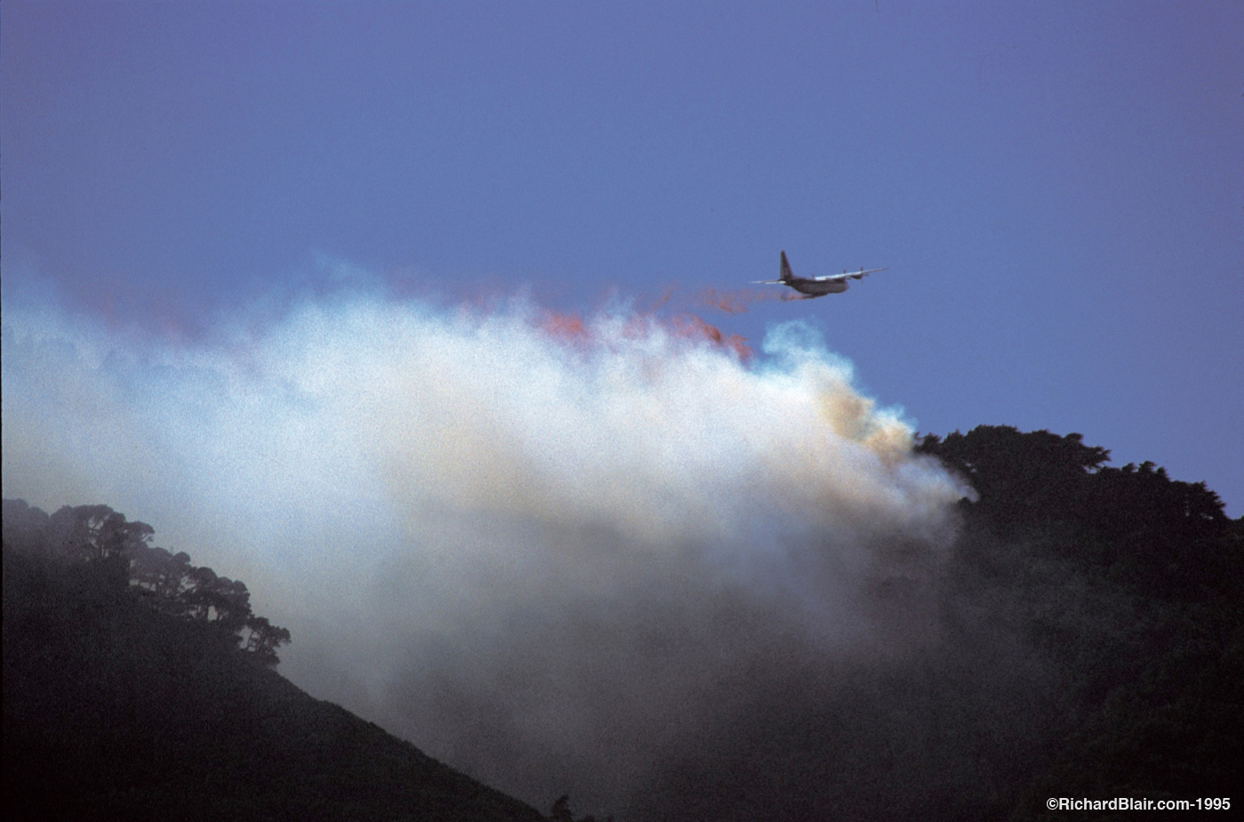 Plane Dropping Fire Retardant