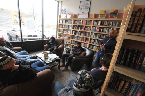Pablo Sierra, owner of Walls of Books D.C., leads a discussion.