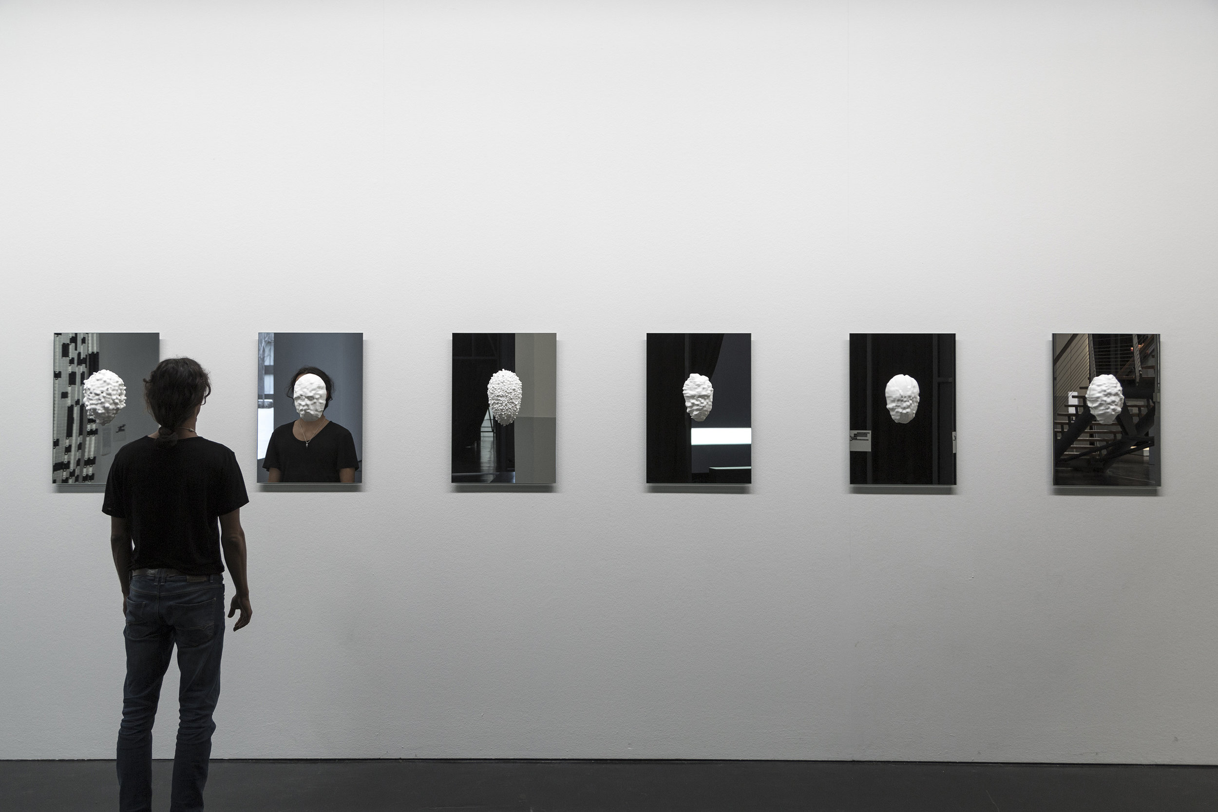 Sterling Crispin,   Data-Masks (Series) ,  2015 3D Printed Nylon, Mirror, Facial Recognition and Detection Algorithms, Genetic algorithms  18 x 26 inches | 45.7 x 66 cm each  || Installation View — ZKM Karlsruhe Museum ||
