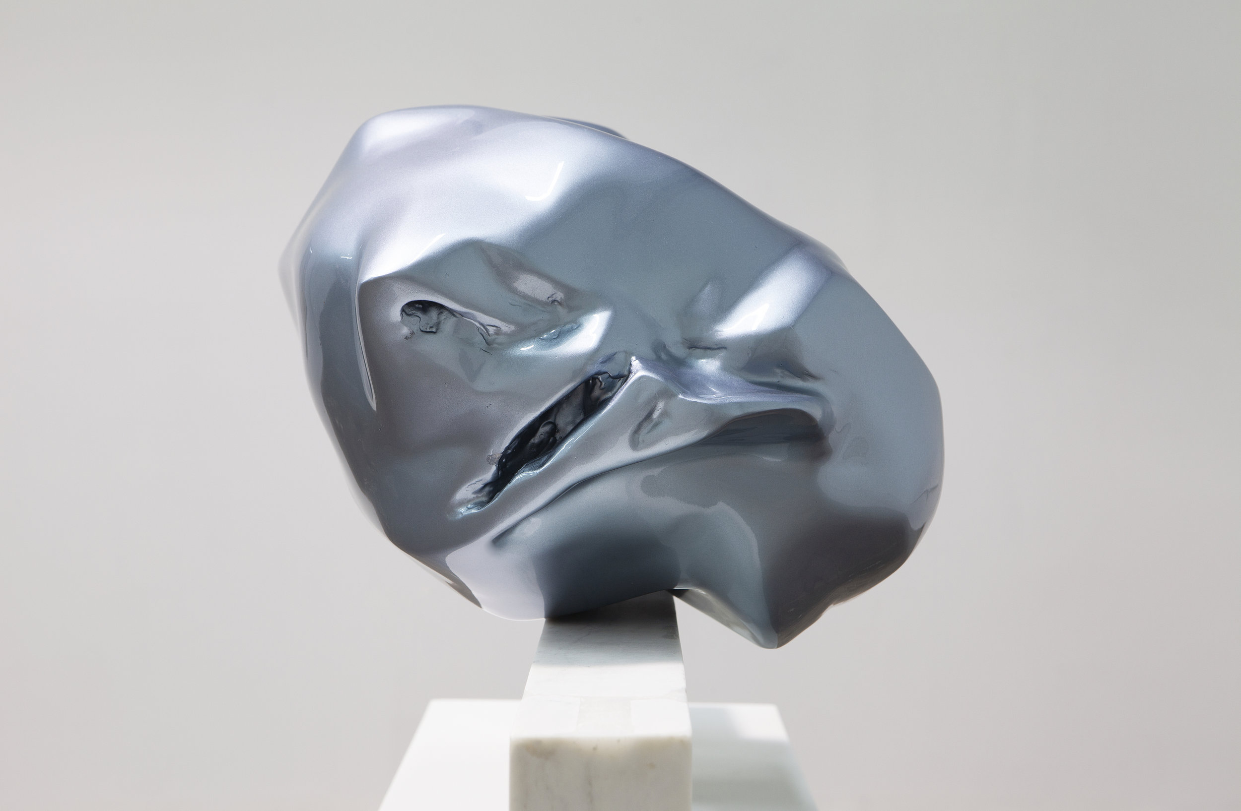 Carol Peligian,  Best Kept (detail) , 2019, Aluminum and painted fiberglass on marble, 21 × 48 × 18 inches