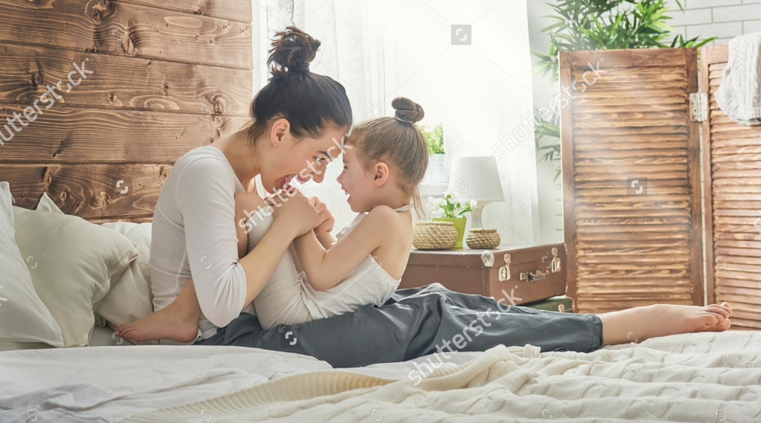 stock-photo-happy-loving-family-mother-and-her-daughter-child-girl-playing-and-hugging-413998000.jpg