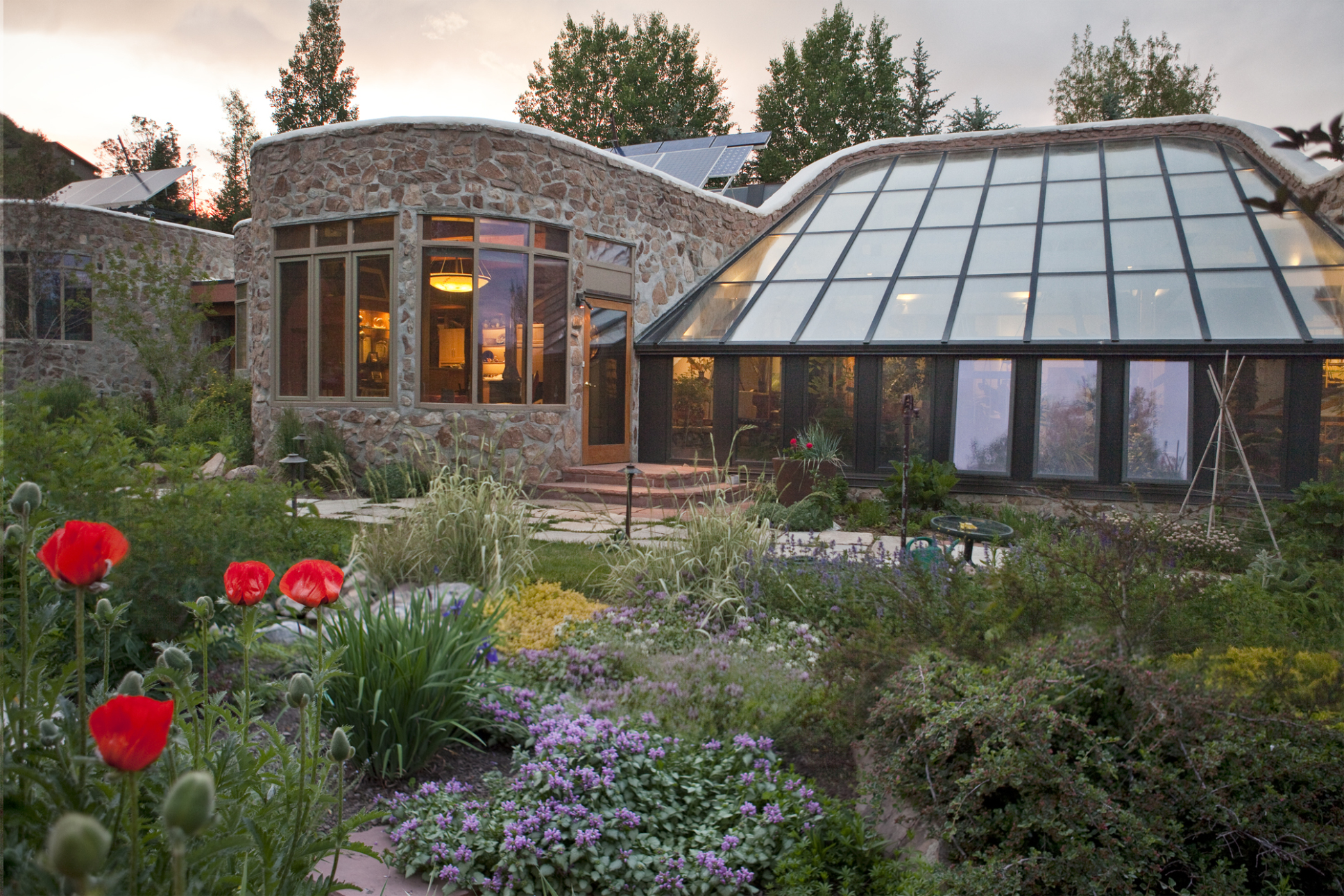 Evening summer view of the outdoor garden at the Banana Farm (in Colorado)    Proto credit: Judy Hill Lovins