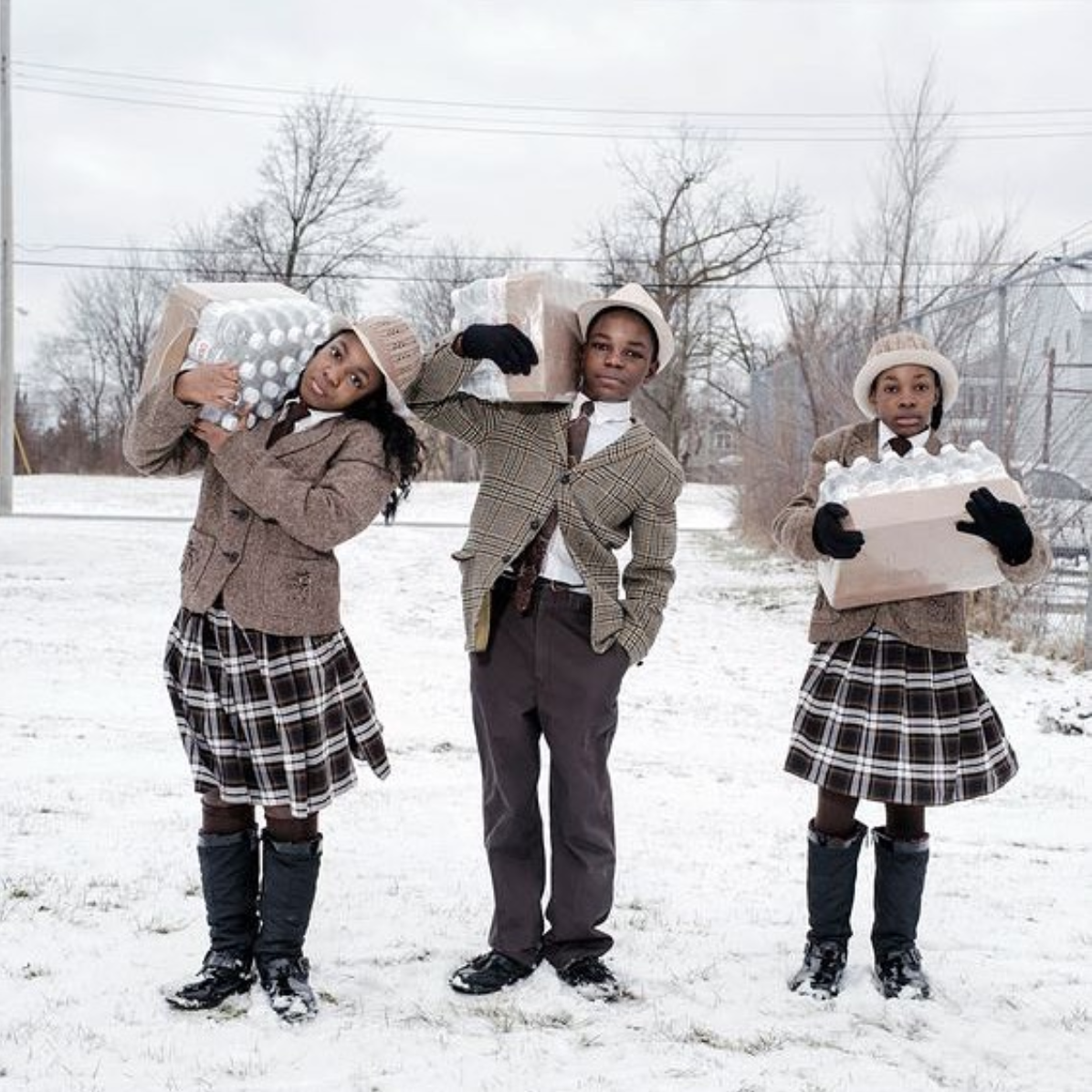 "Instagram:    genusee_official     ""Siblings Julie, Antonio, and India Abram collect their daily allowance of bottled water from Fire Station  #3 . Located on Martin Luther King Avenue, it is one of five firehouses that have become water resource sites in Flint, Michigan."" - @natgeo.la"