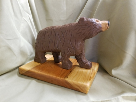 Hand carved brown bear - side view.
