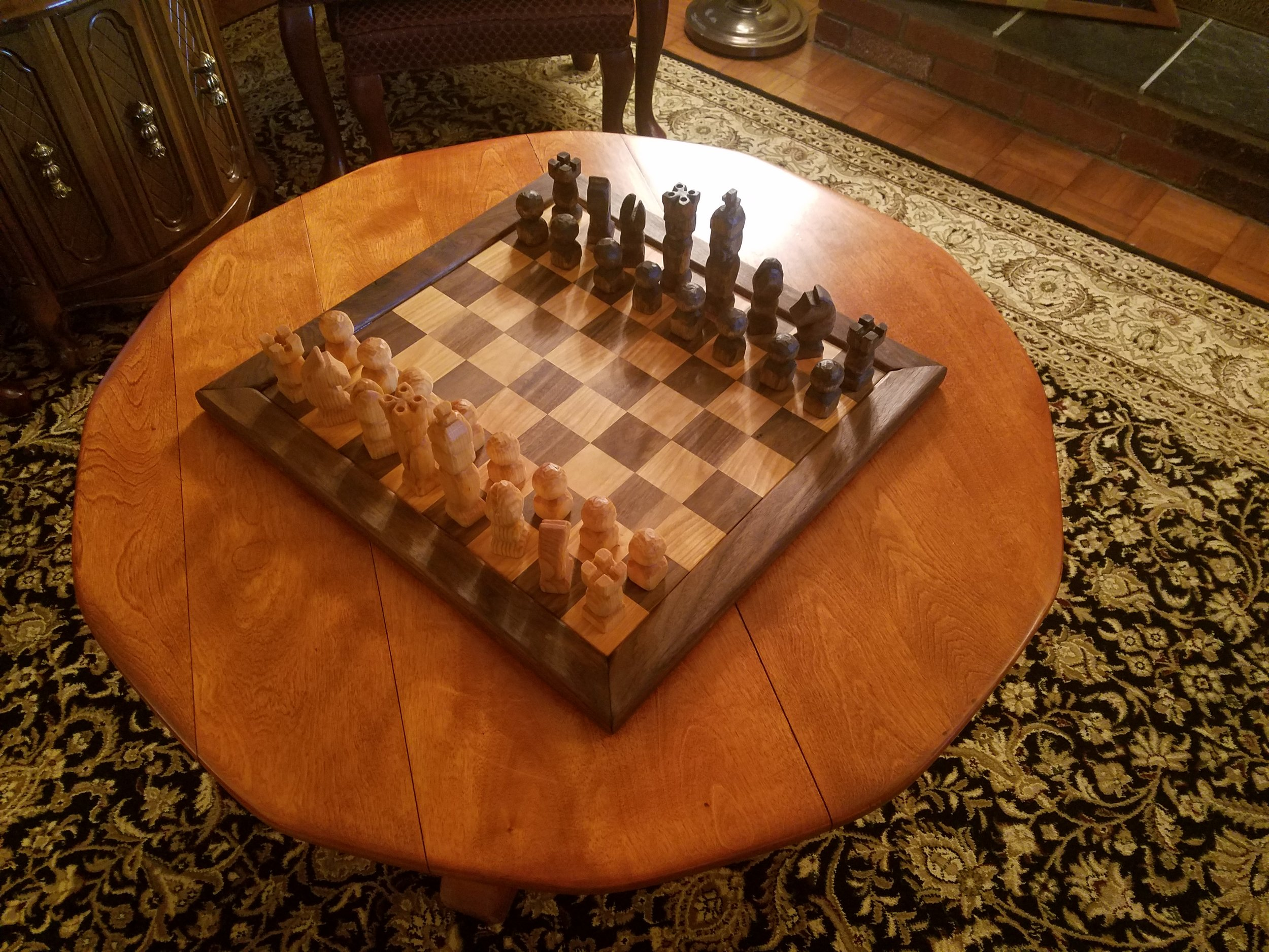 Hand carved chess pieces from basswood … hand made chessboard from walnut and cherry.