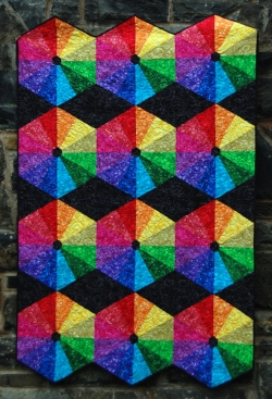ROY: Make this vibrant hexagon quilt in a rainbow (ROY -g -biv) of colors. One column makes a table runner, 3 make a quilt! We'll learn to work with templates, 30 and 60 degree angles and a little English Paper Piecing to finish things off. Easy piecing - no Y seams!