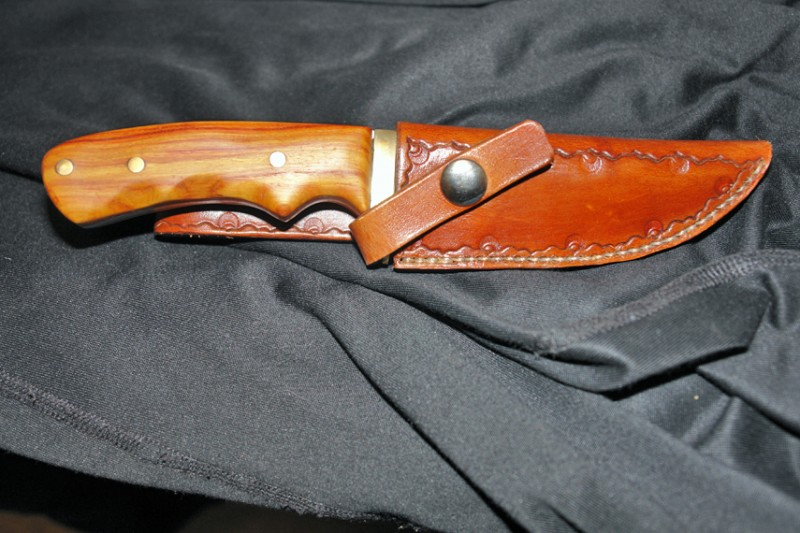 and finally, a sheath to match, and the brass and blade polished up a bit.