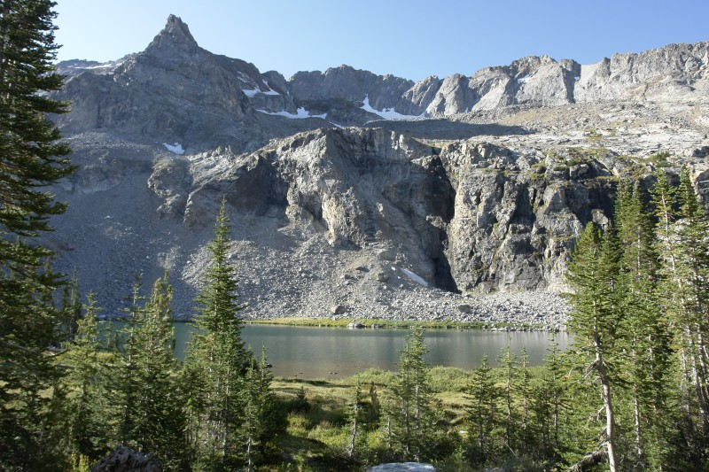 This is the first view you see of the lake. There is a waterfall that comes down the cliff on the opposite side of the lake, and another waterfall where the inlet to the lake cascades down from the basin above.