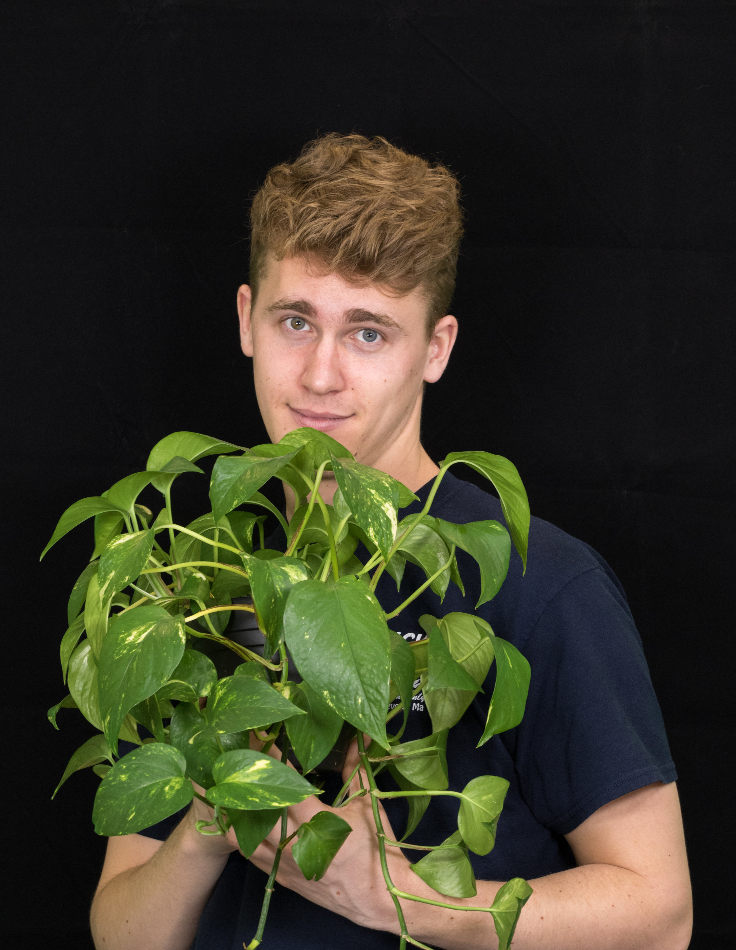 Ben with plant.jpg