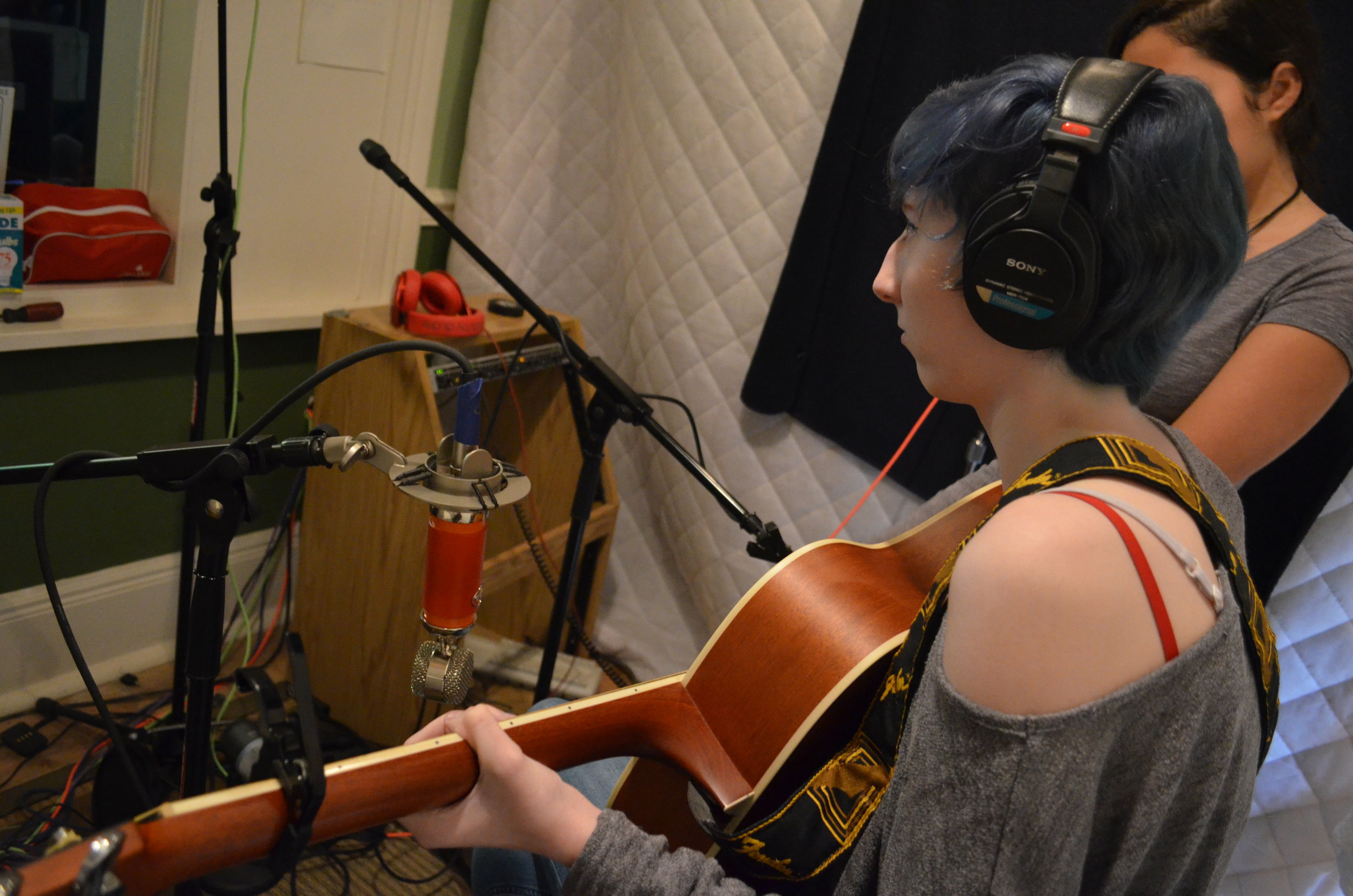 Lee M. and Sarah H. recording their song at Otis III's recording studio.