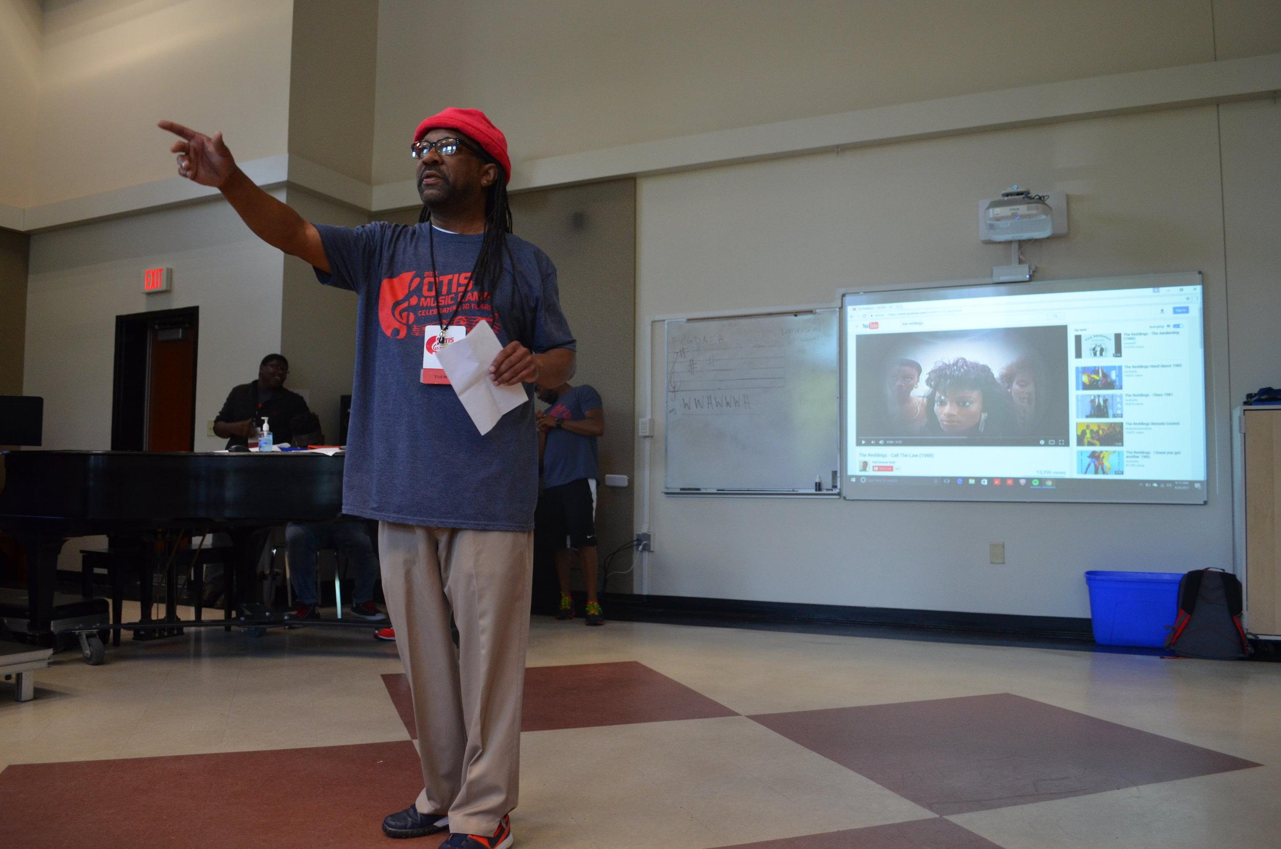 Coach Ted teaching music theory.